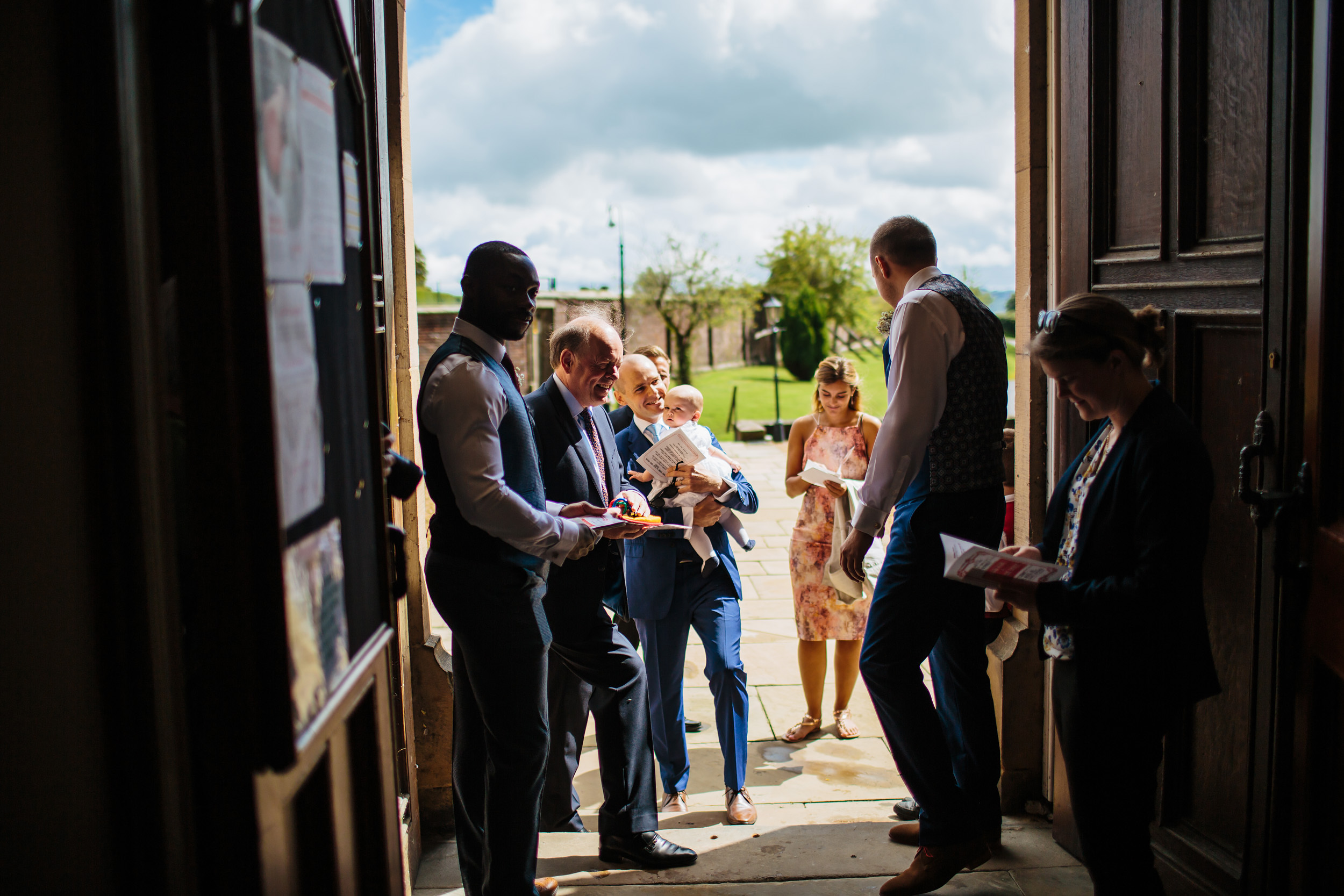 Wedding guests enter the church at Stonyhurst College Lancashire