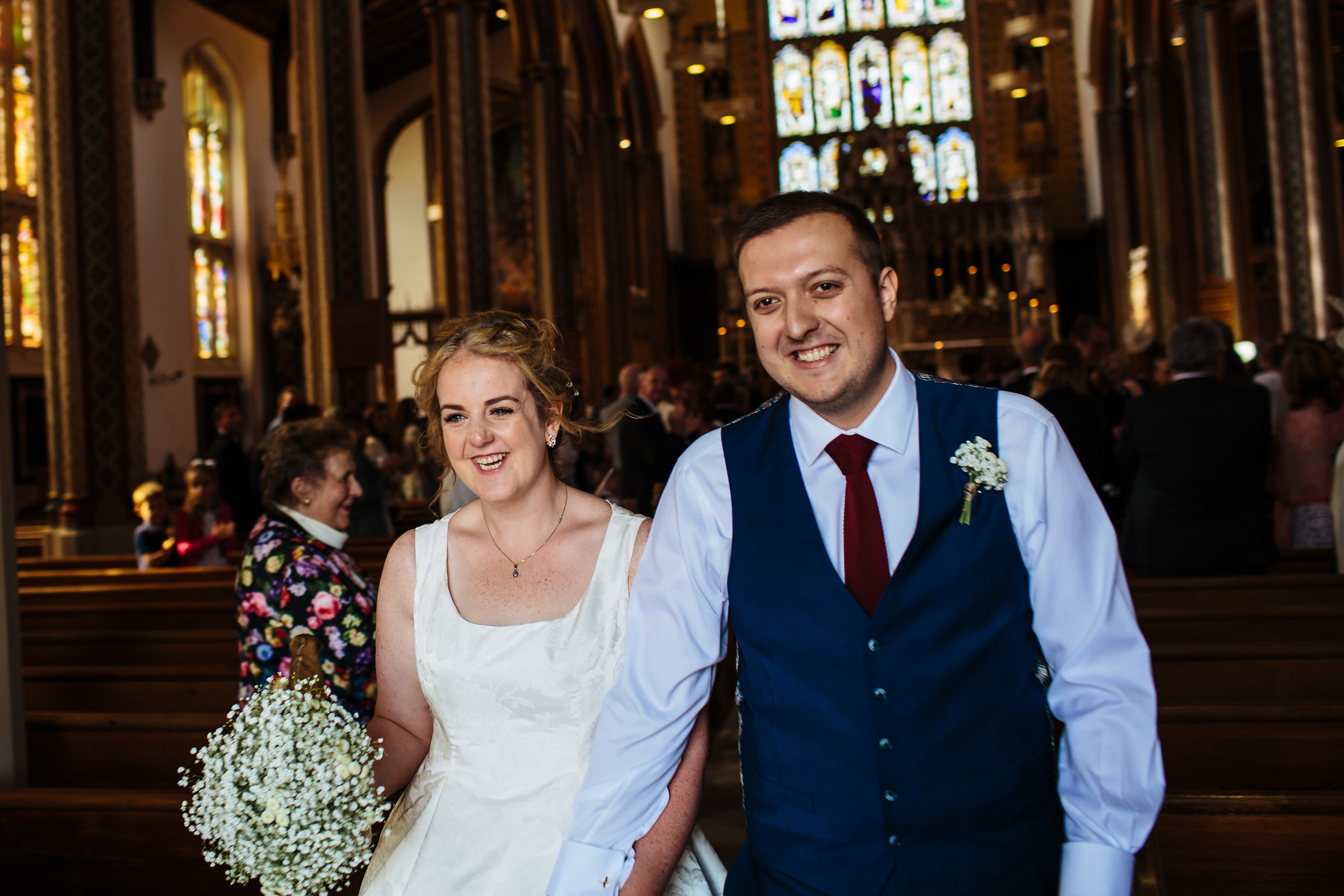 Bride and groom walking down the aisle at their wedding in Lancashire