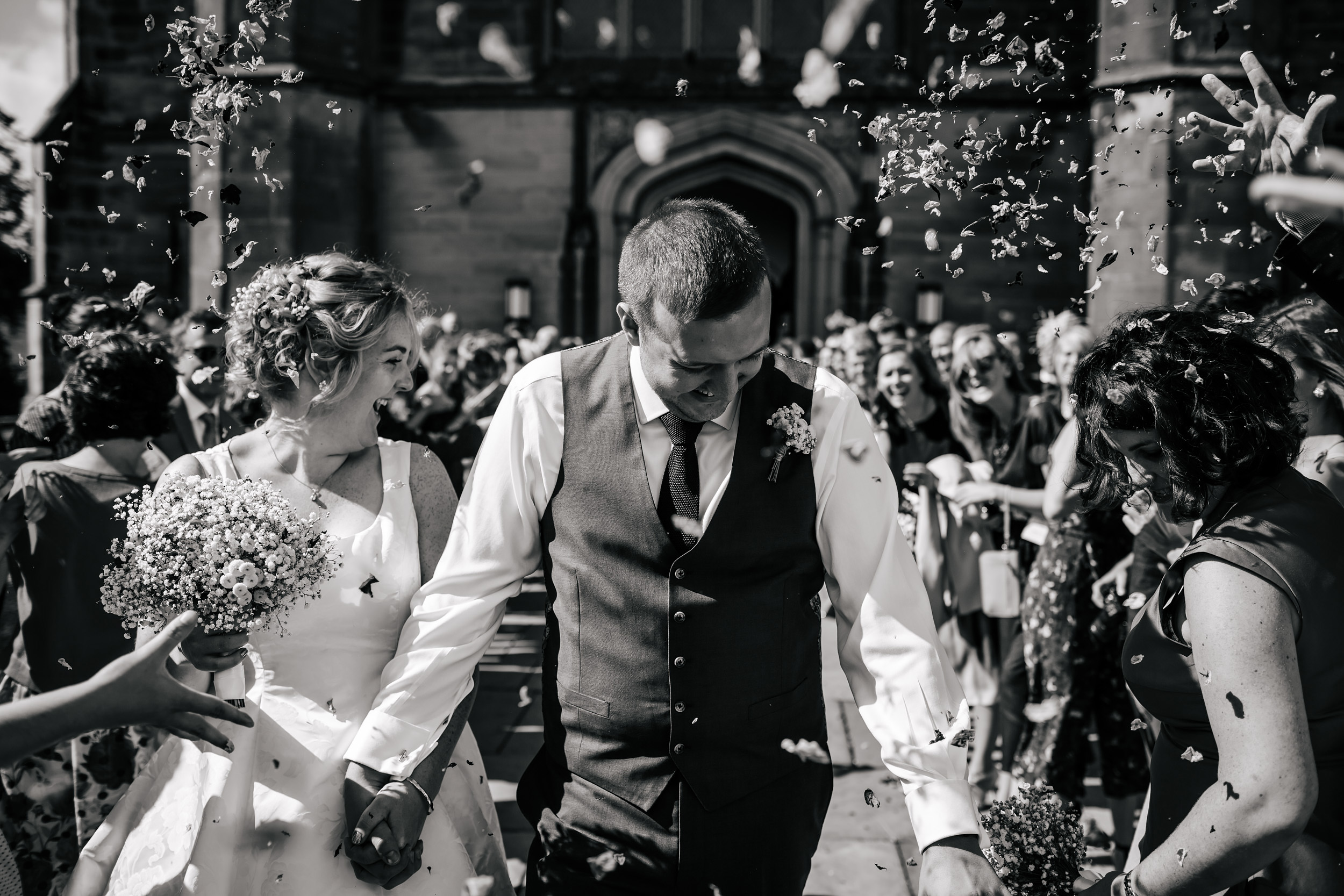 Bride and groom with confetti on their wedding day