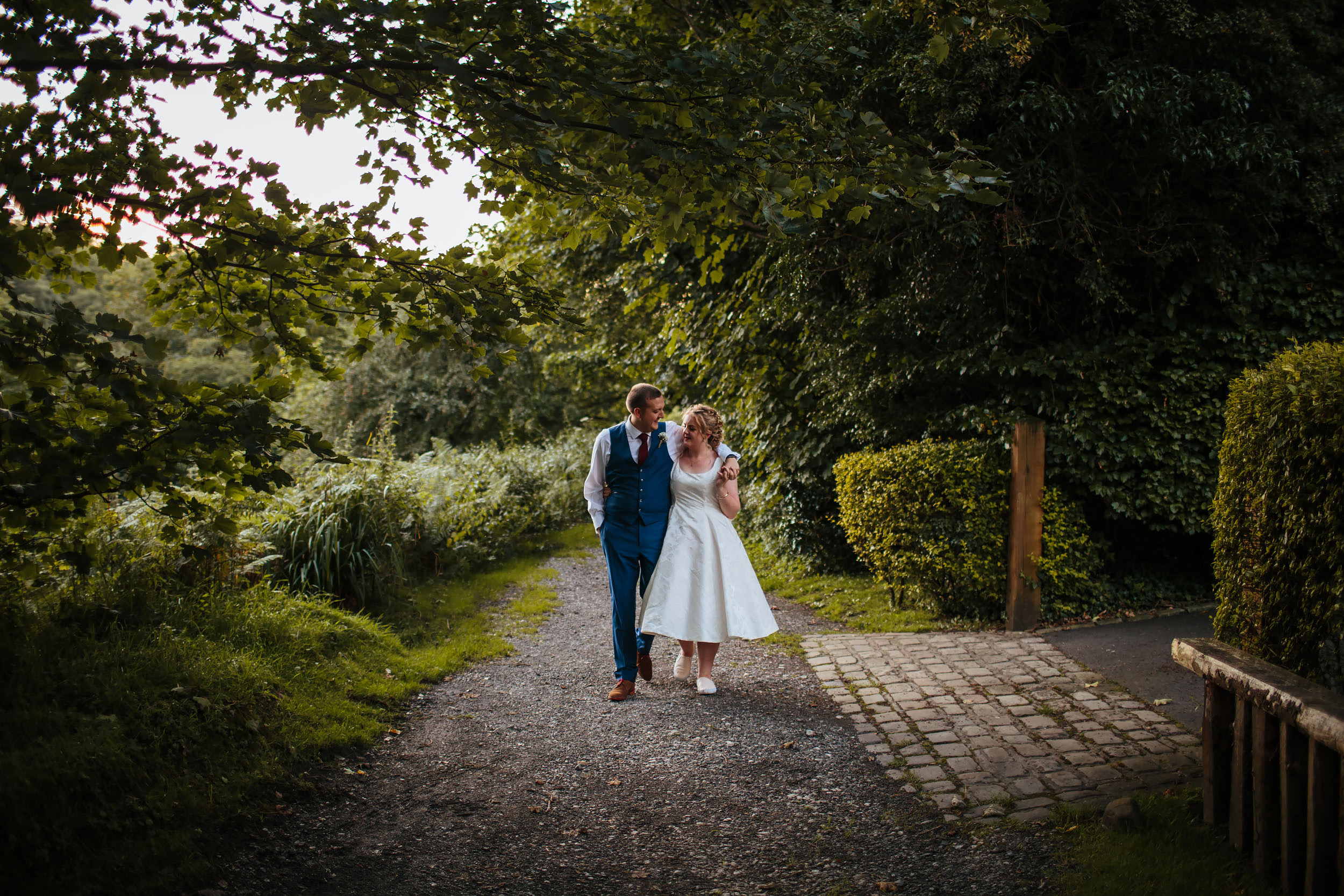 Bride and groom pose for a photograph on their wedding day