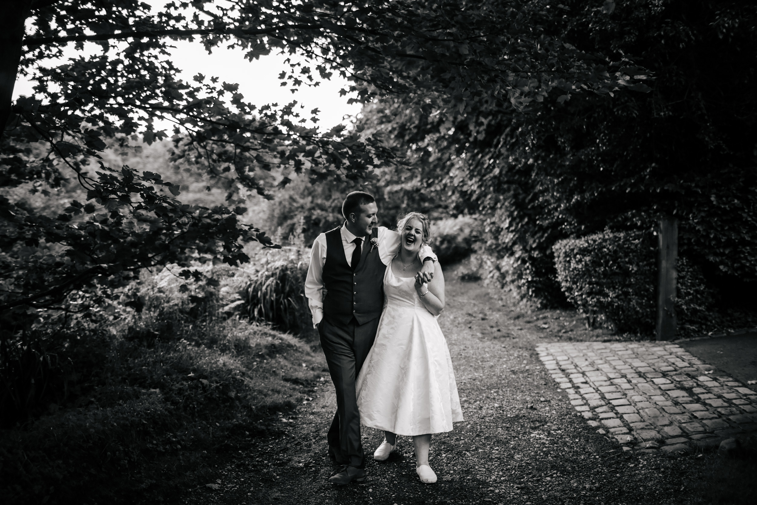 Bride and groom laughing in the Lancashire countryside