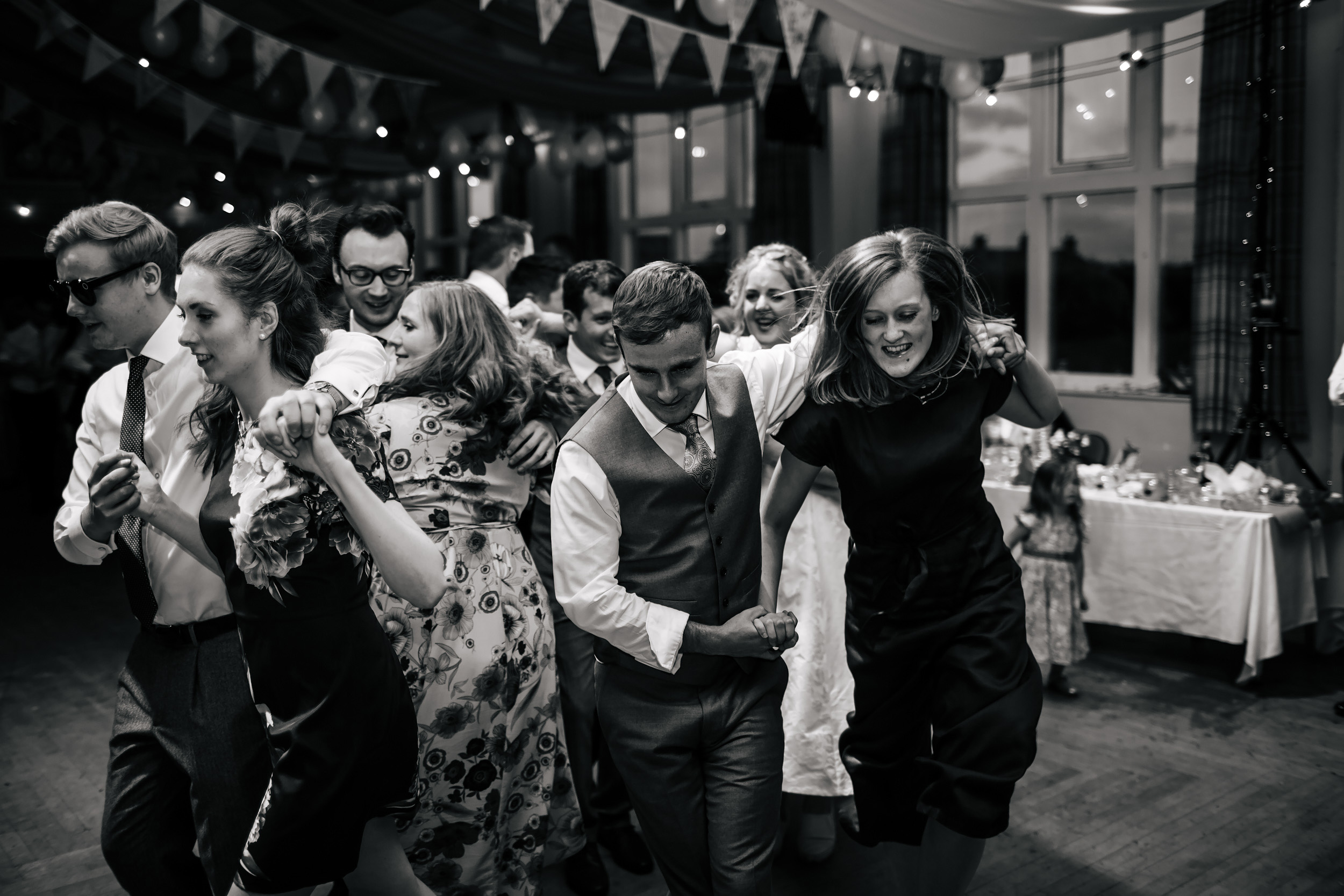 Wedding guests dance at a ceilidh