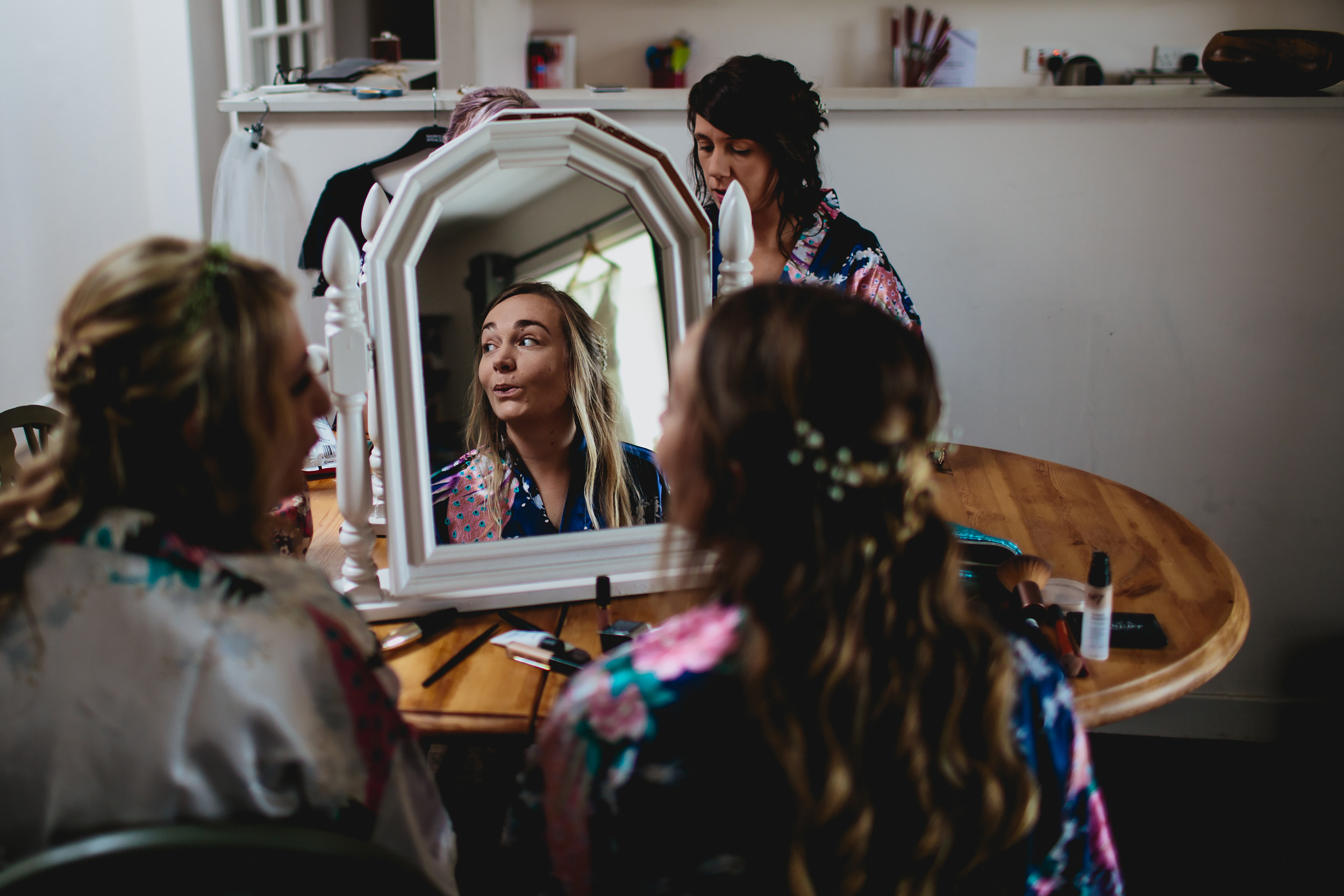 Bride applying her make up in Crail for a wedding in Scotland