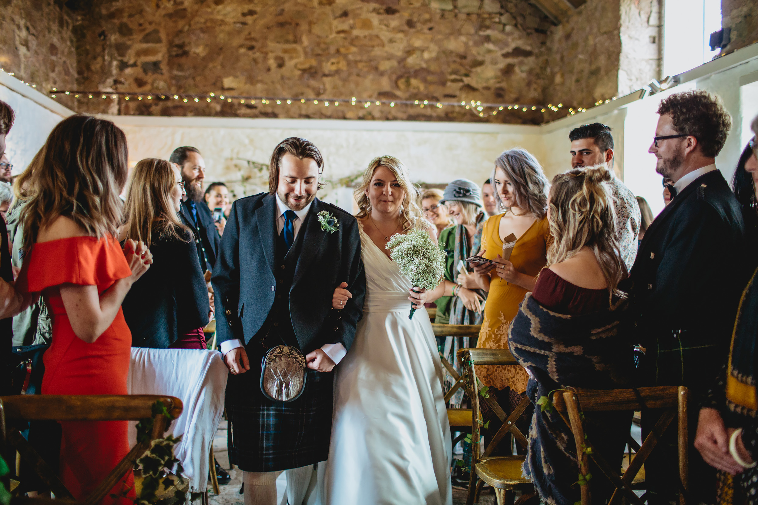 Bride walks down the aisle at a Cow Shed Crail wedding