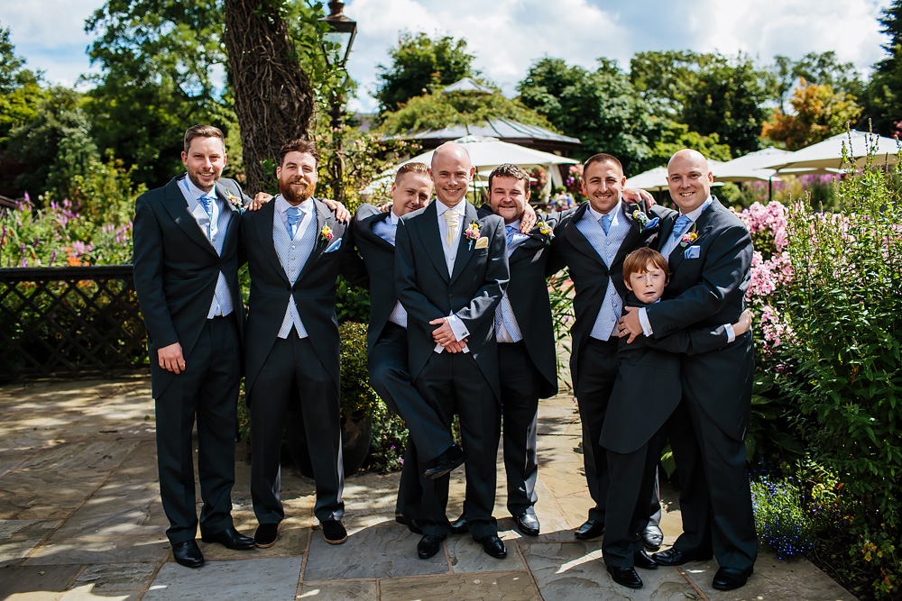 Group shot with the groomsmen at Gibbon Bridge Hotel Lancashire wedding