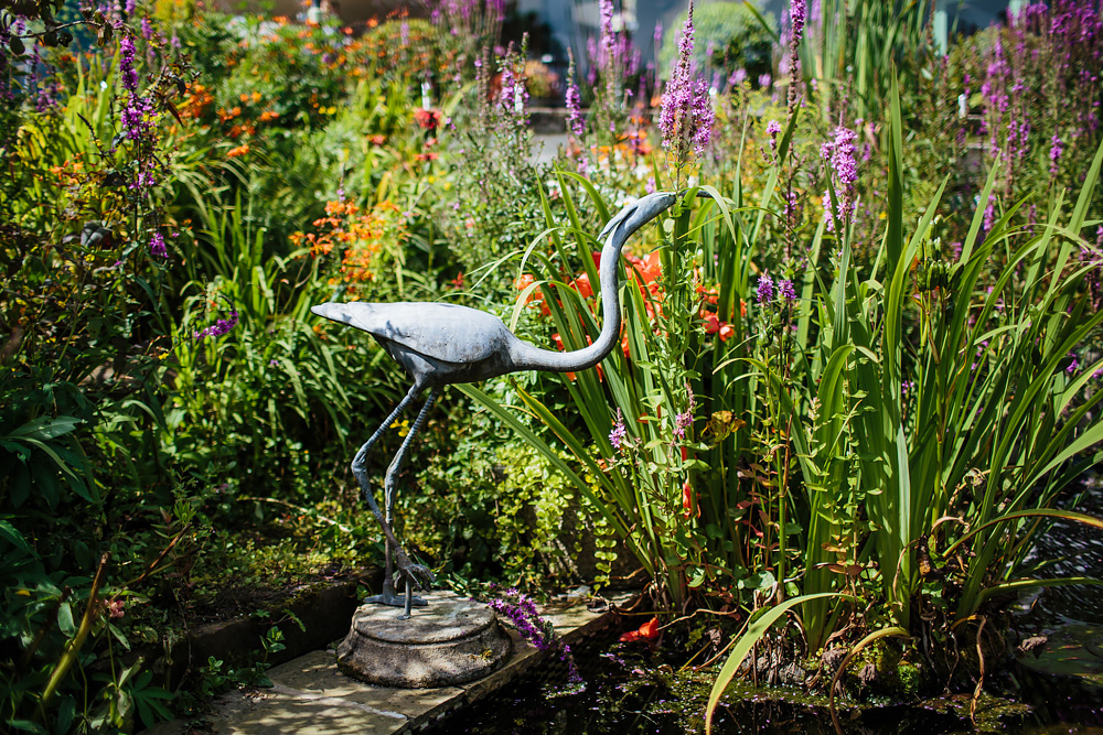 Garden bird ornament in the sunshine