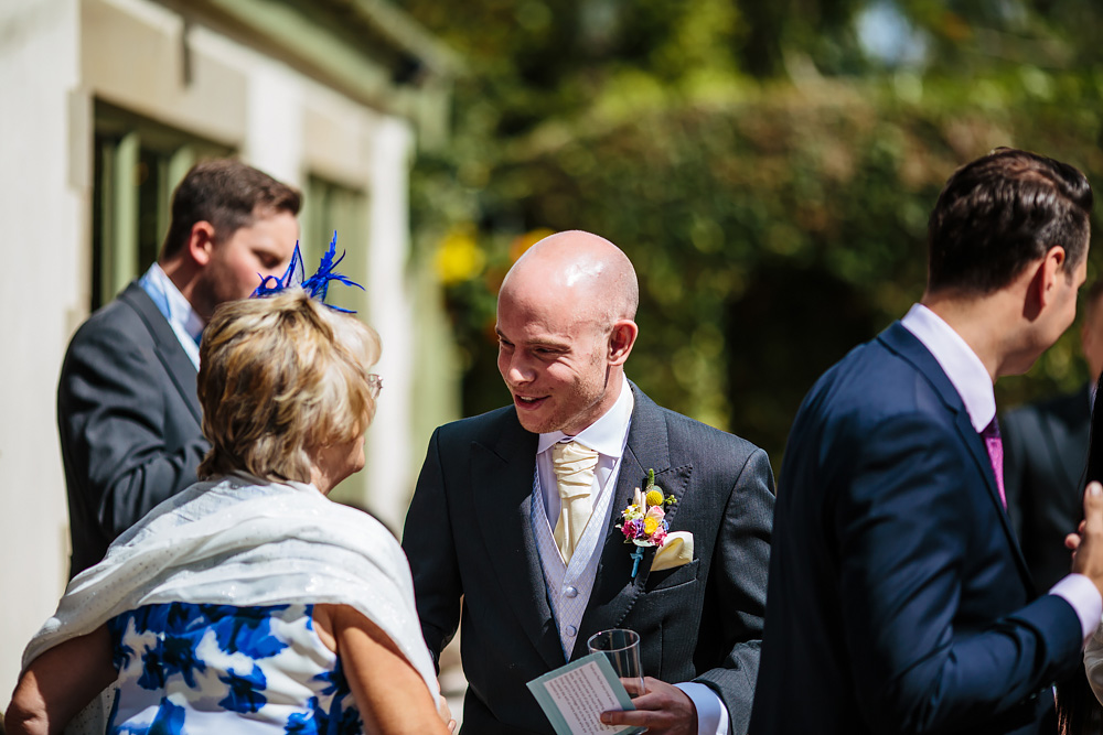 Groom welcomes wedding guests in Lancashire