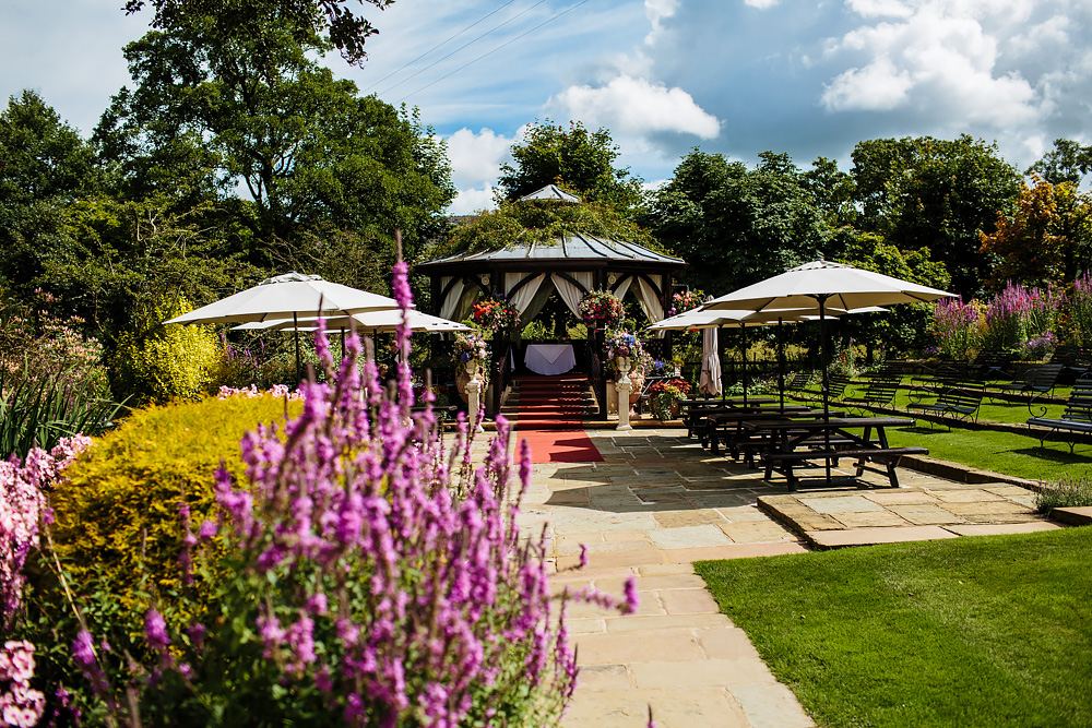 Bandstand and flowers in the sunshine at Gibbon Bridge Hotel