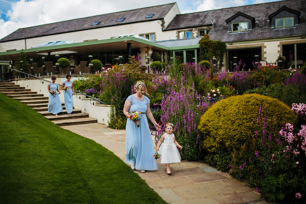 Bridesmaids walking towards the ceremony Gibbon Bridge Hotel Lancashire wedding