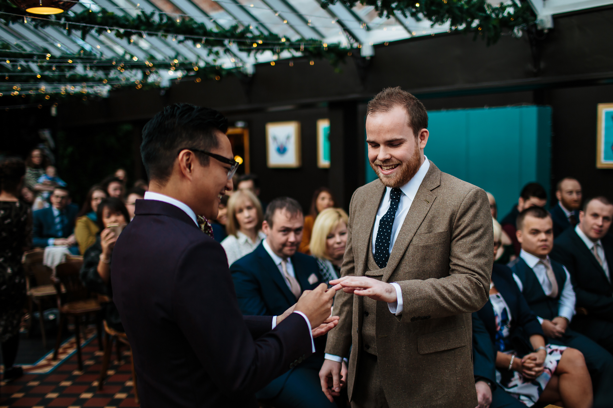 Groom placing the ring on his husband's finger in Yorkshire