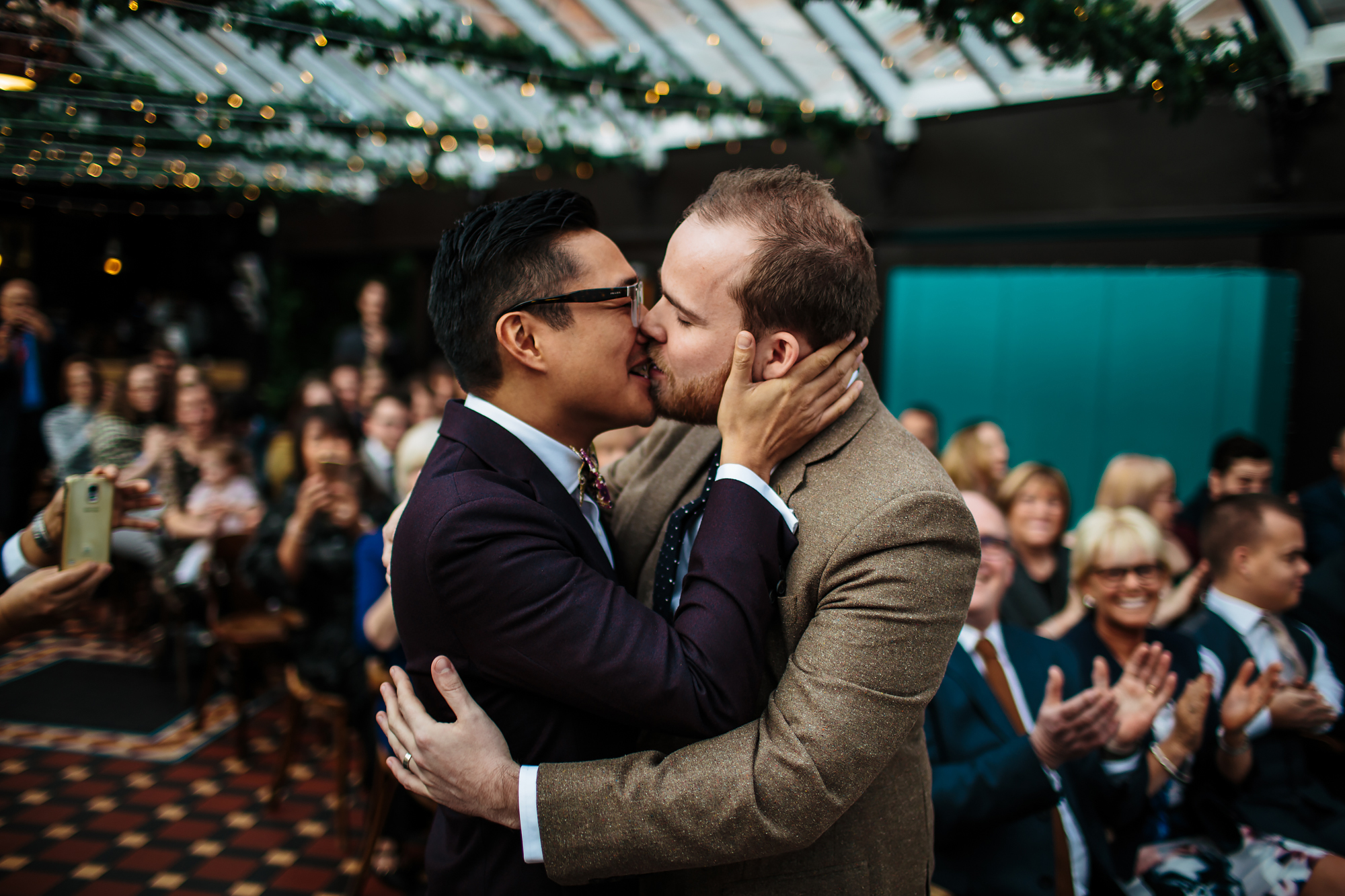 Grooms kissing at a gay wedding in Yorkshire