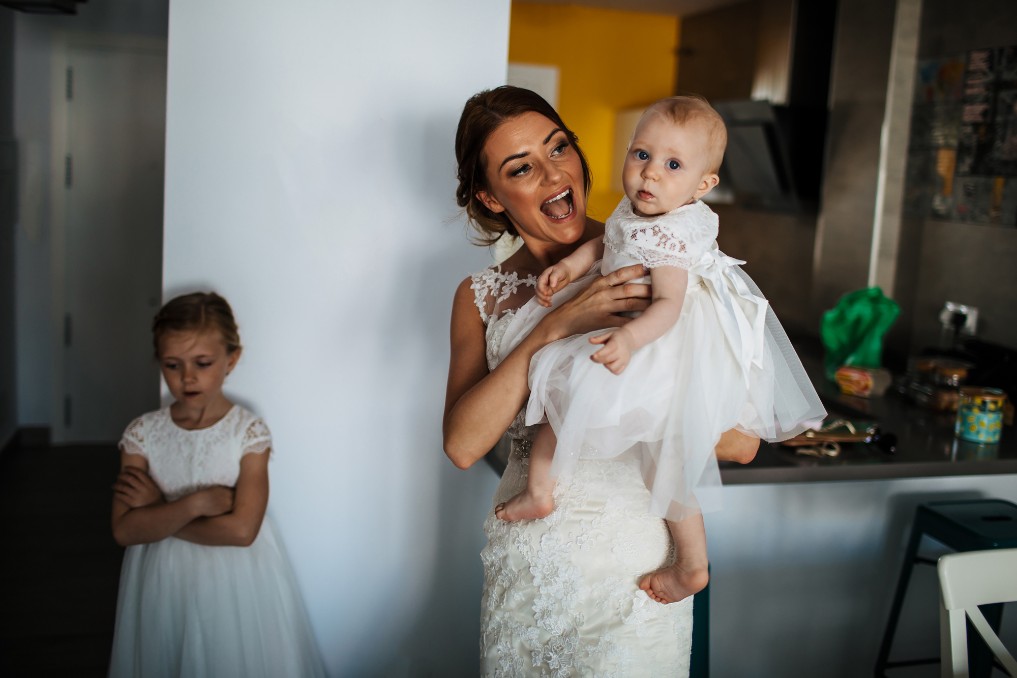 Bride holding daughter before her wedding in Nerja Spain