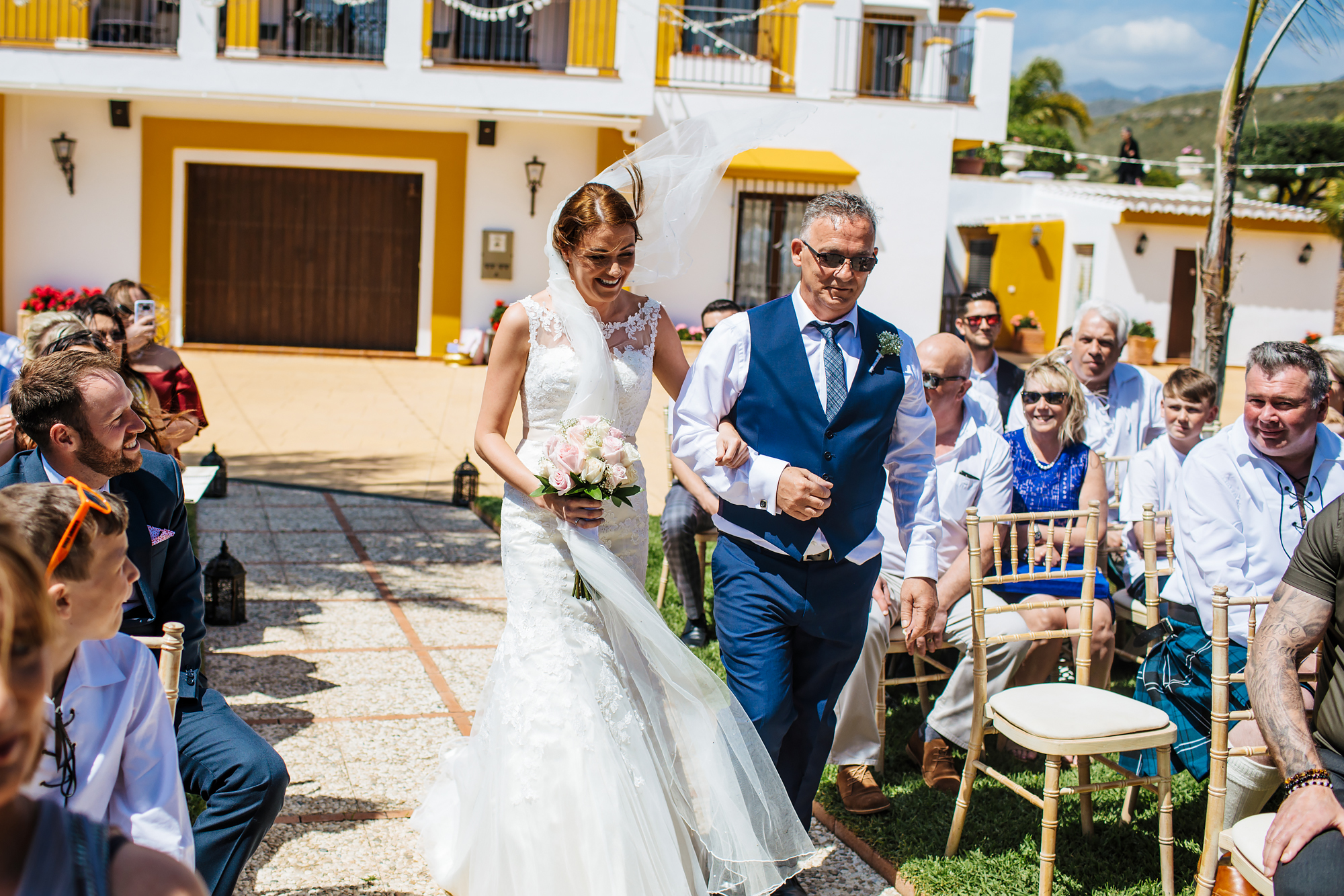 Bride and father walk down the aisle at Cortijo Maria Luisa Nerja Spain