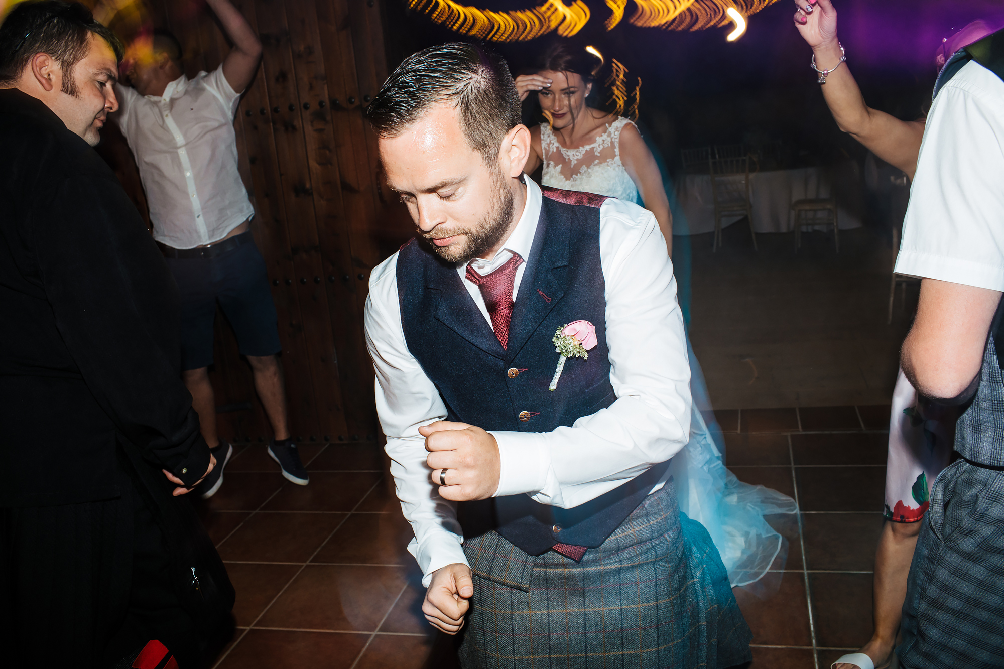 Groom dancing at a wedding in Nerja Spain