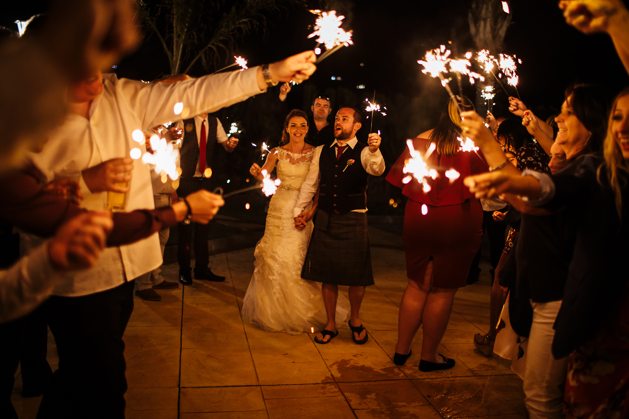 Bride and groom with sparklers at a wedding