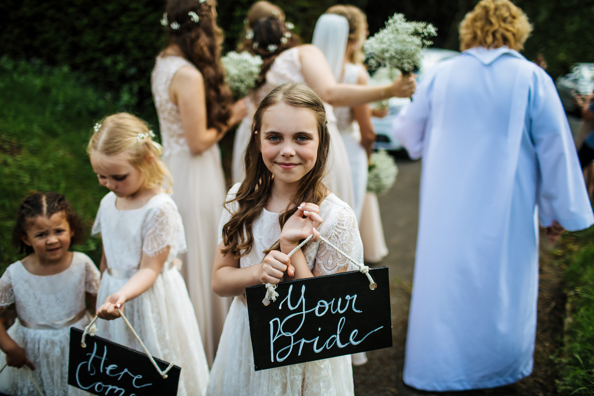 Young bridesmaid outside a church wedding