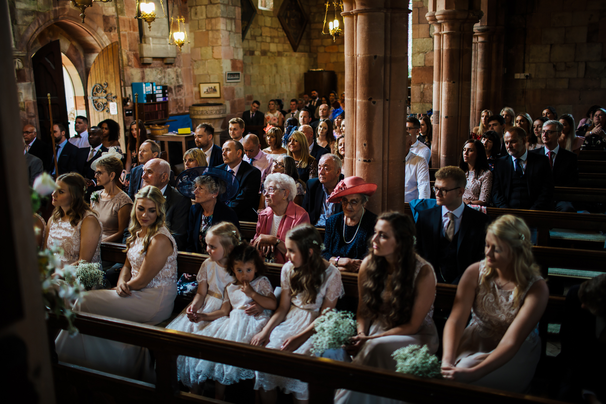 Wedding guests and bridesmaids in the church