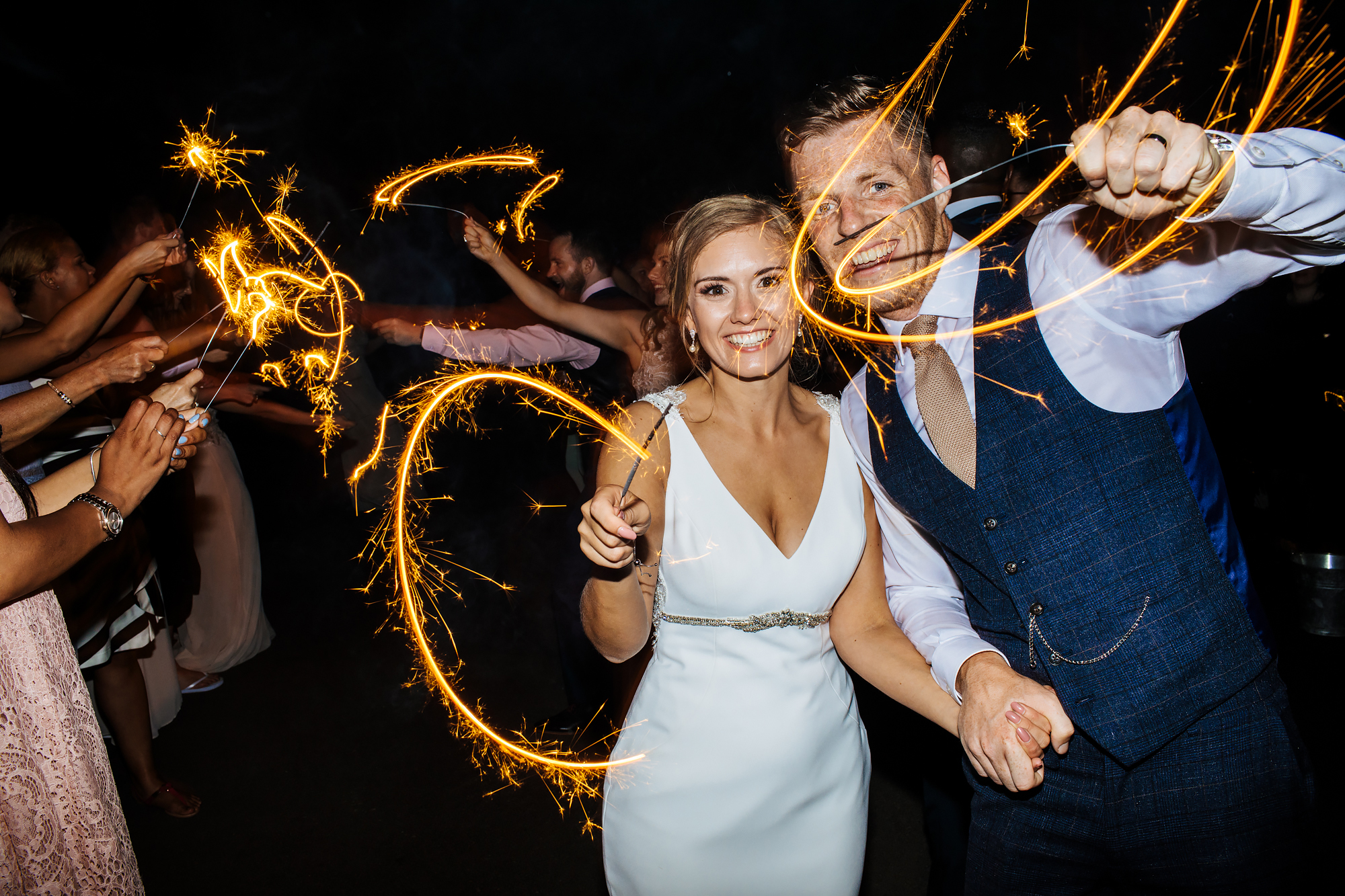 Bride and groom with sparklers at Mill Barns Wedding Venue Shropshire