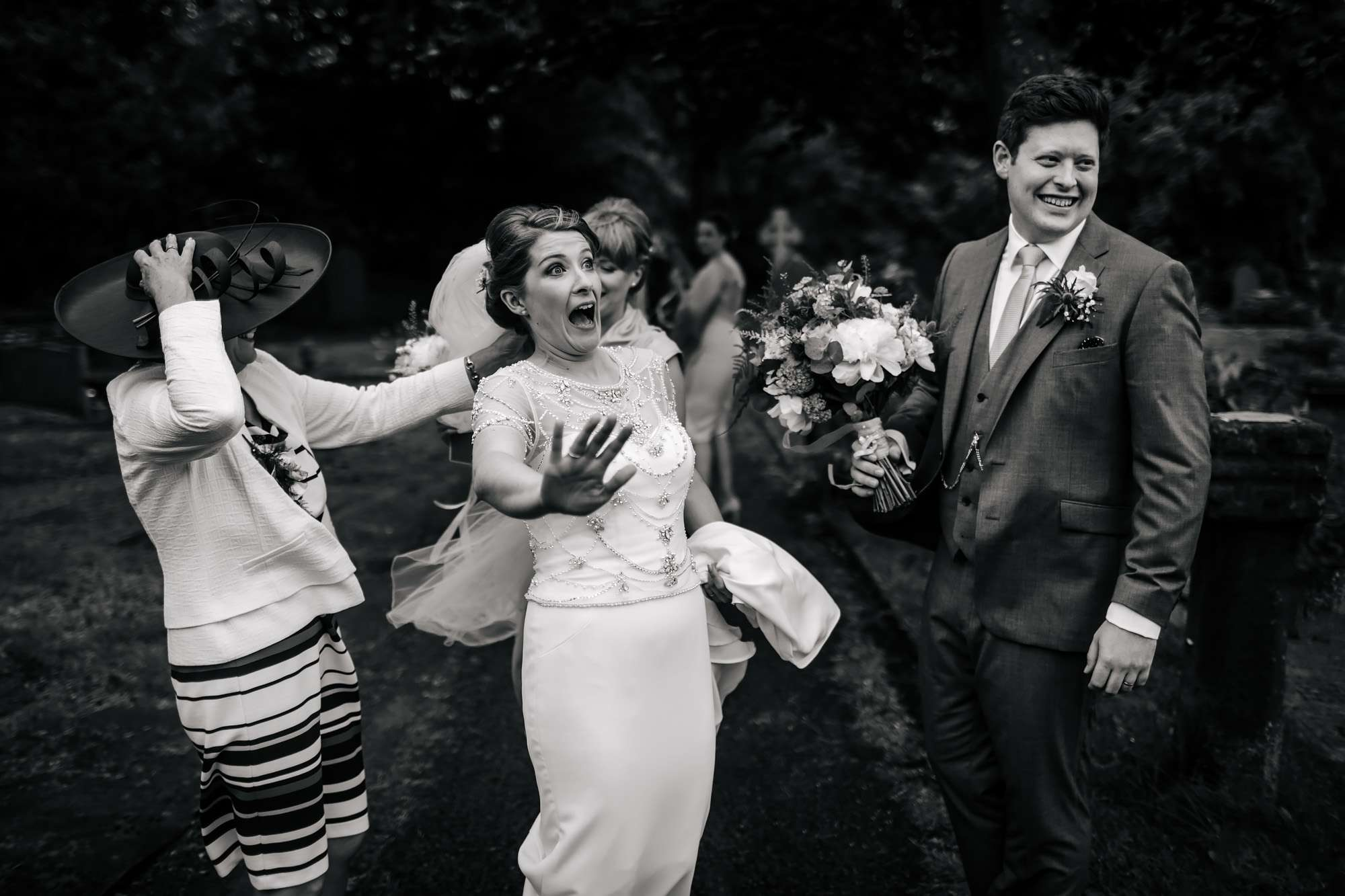 Bride Laughing as her veil blows away