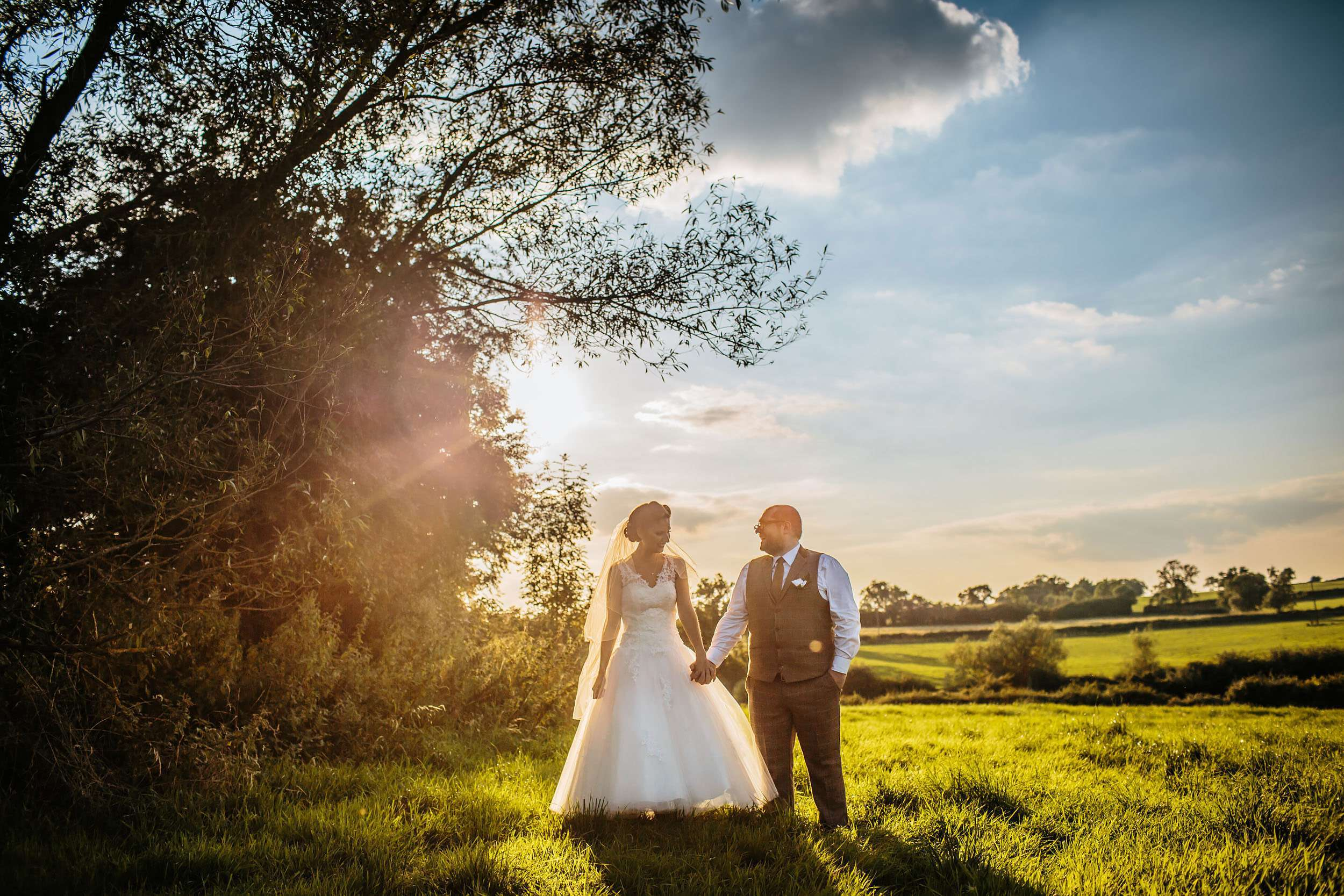 Bride and groom at sunset in a gorgeous field