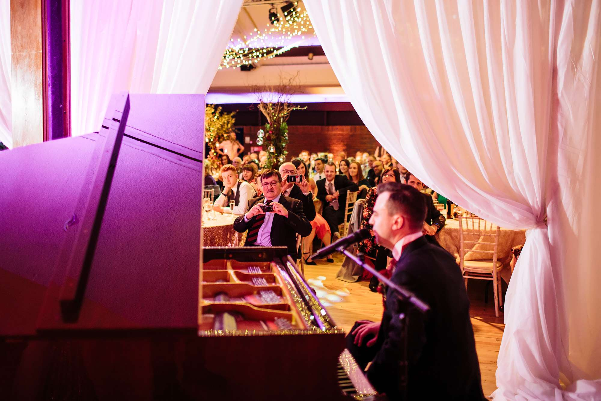 Groom plays the piano during his wedding speech