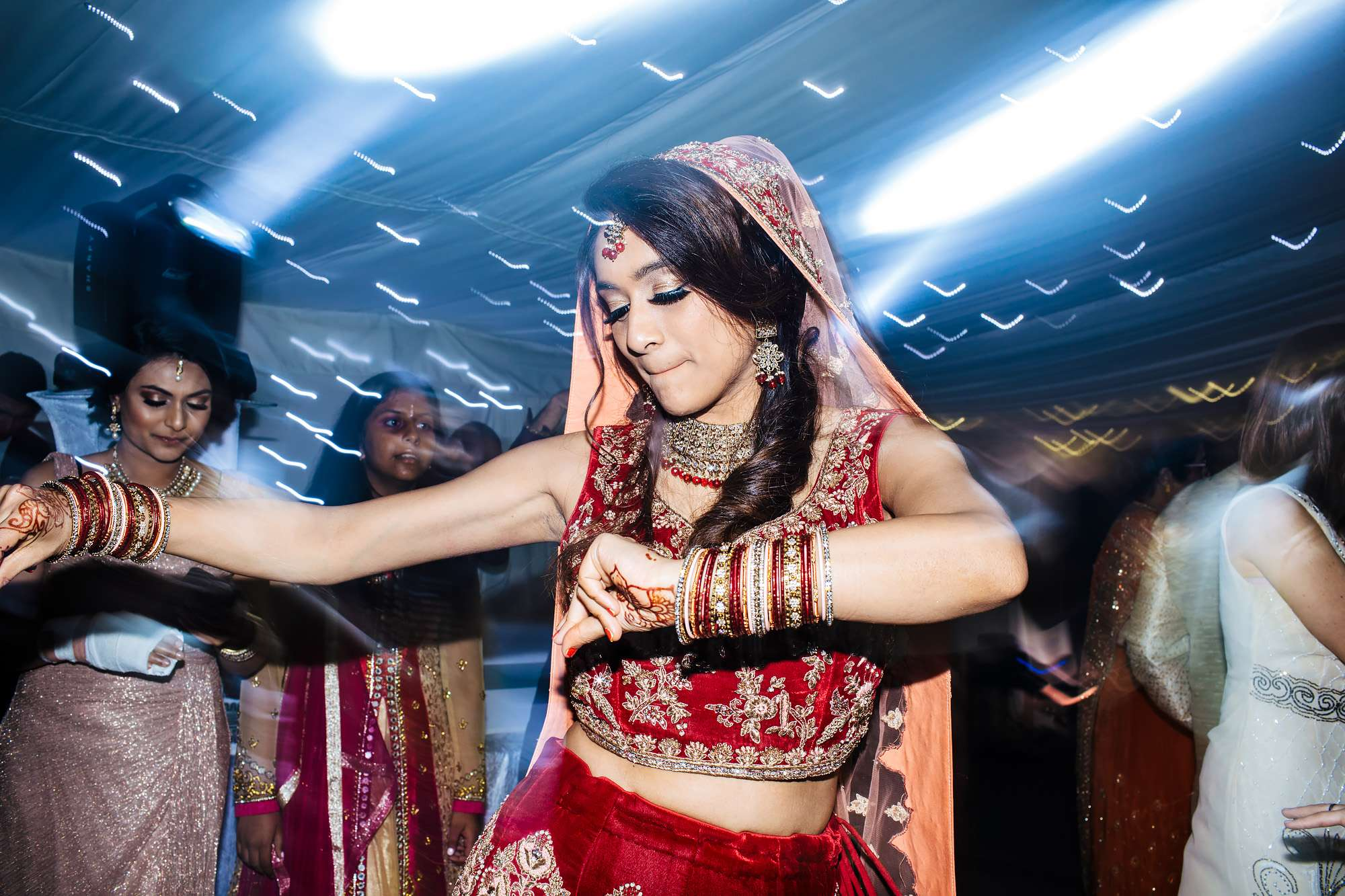 Asian bride dancing at her wedding
