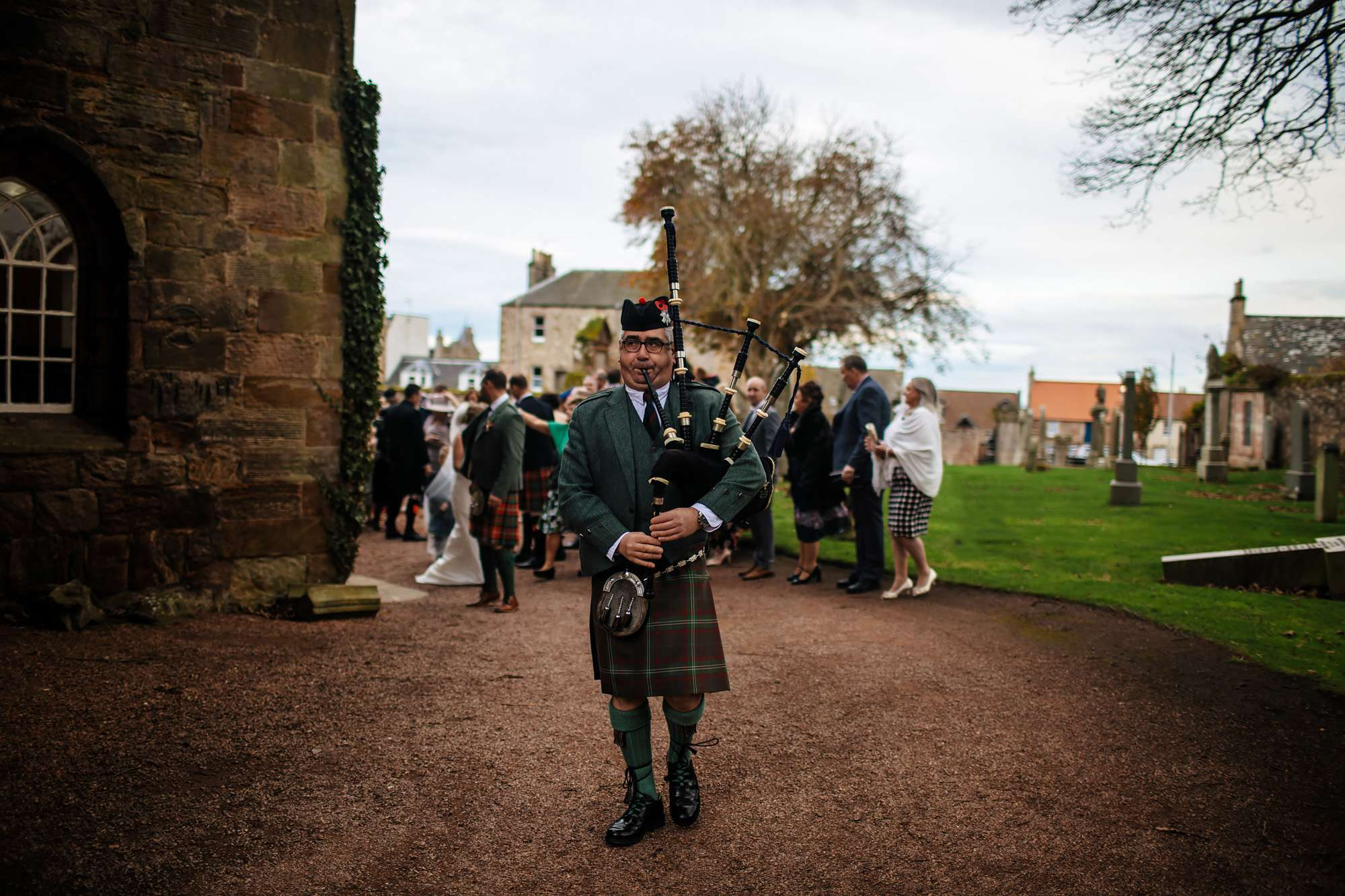 Piper at a church wedding in Scotland