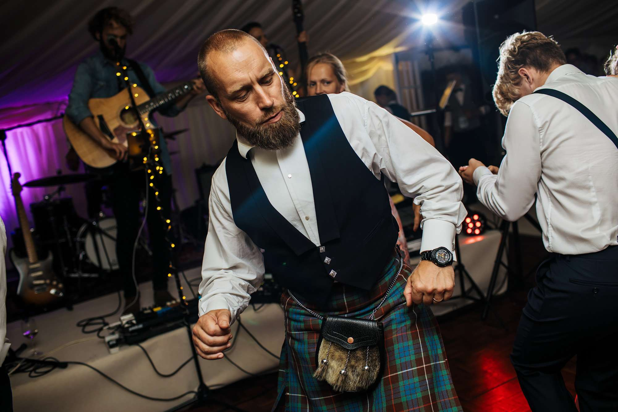 Guest in kilt dancing at a Yorkshire wedding