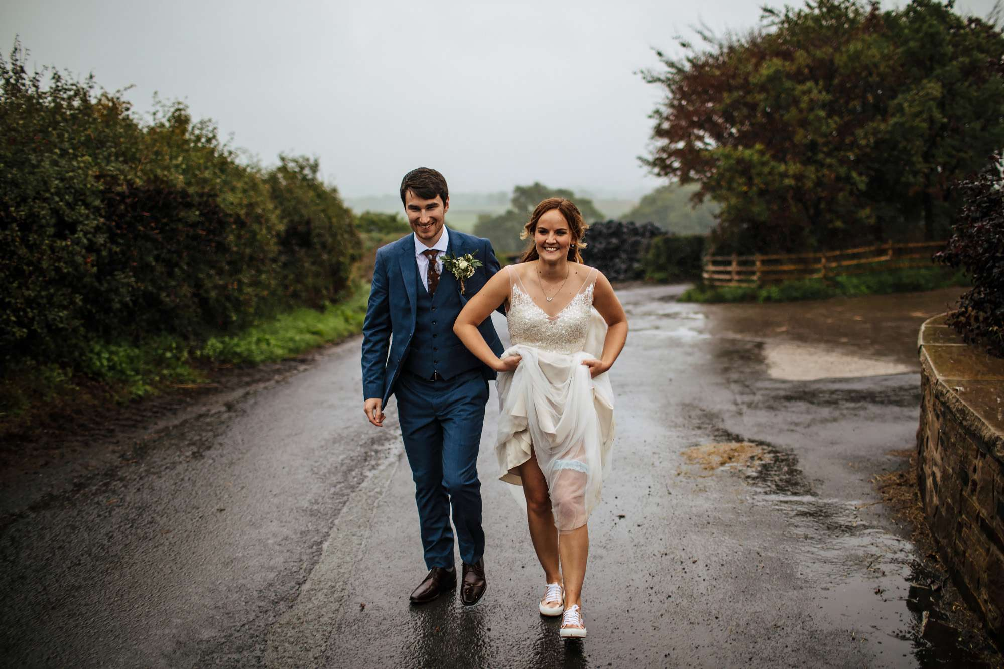 Bride and groom in the rain at a Harrogate wedding