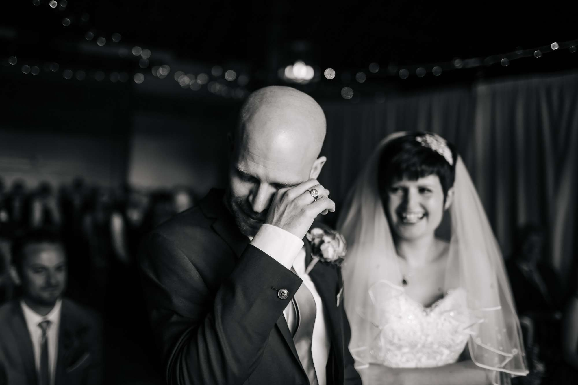Groom crying during his wedding ceremony