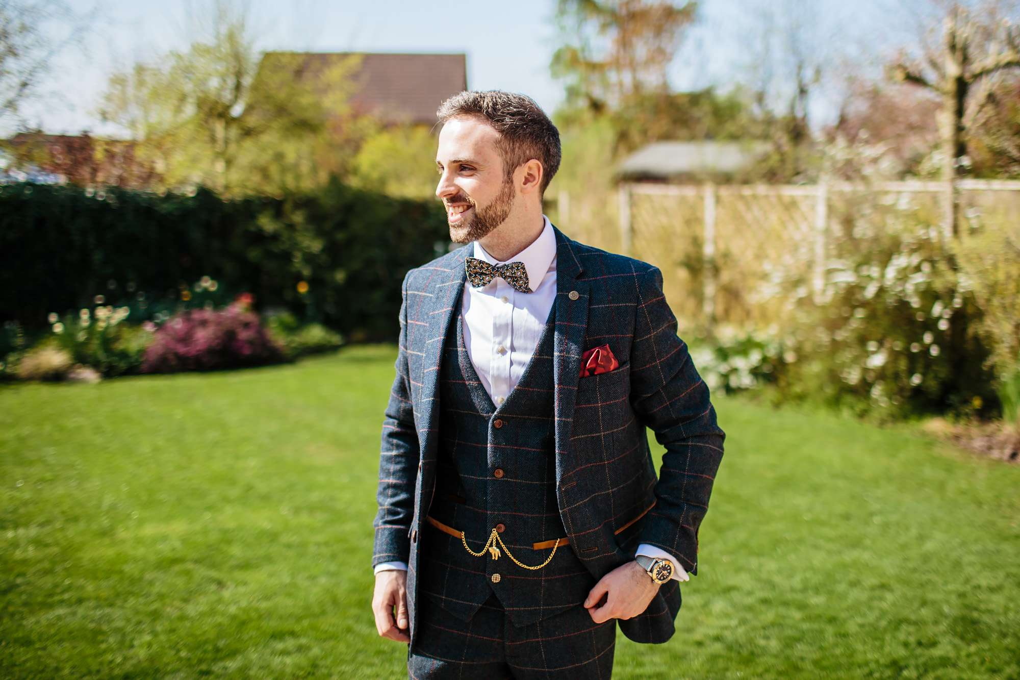 Groom in the garden on his wedding day
