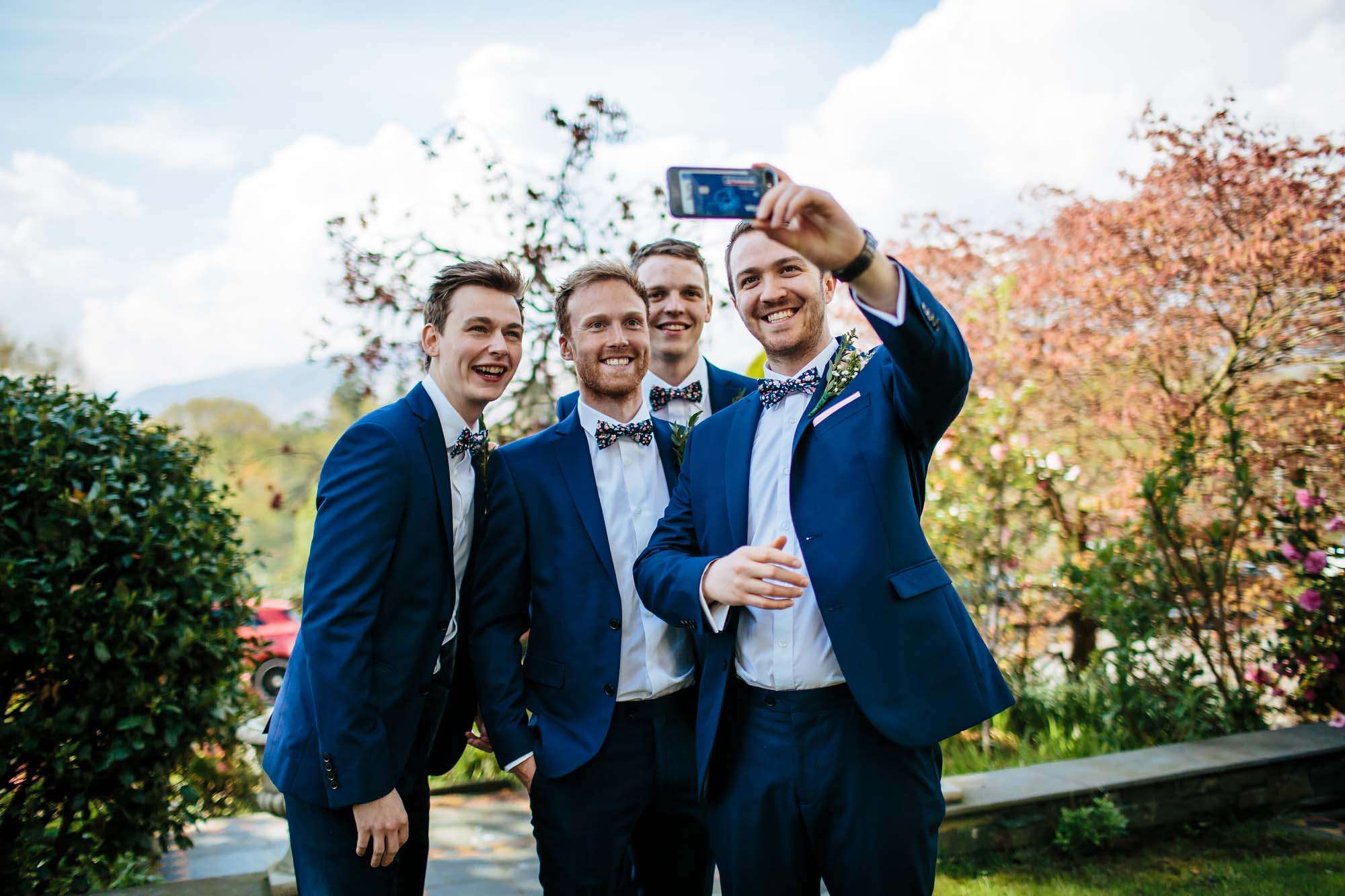Guests taking a selfie at a wedding