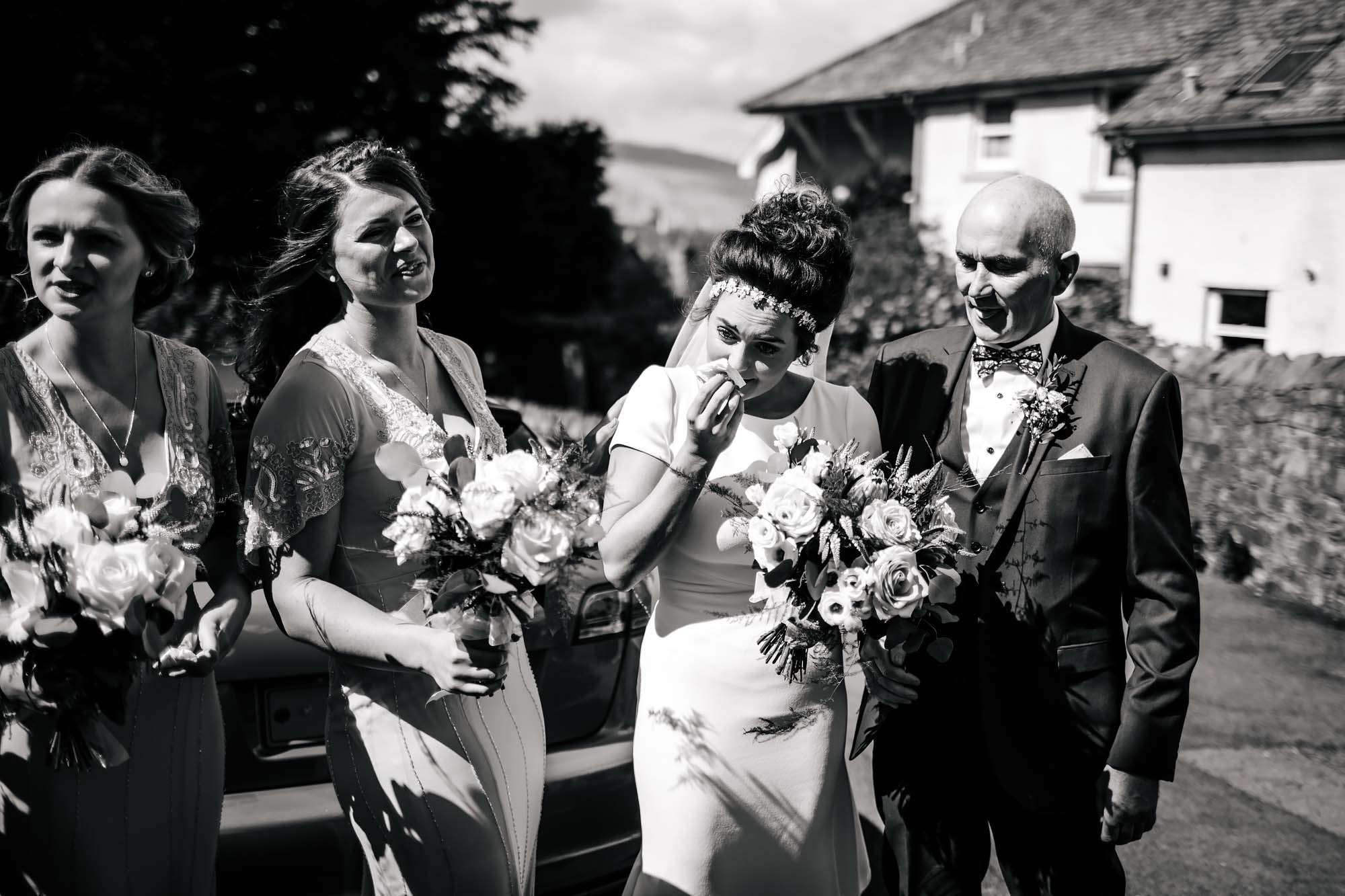 Bride cries with her dad before her wedding in Keswick