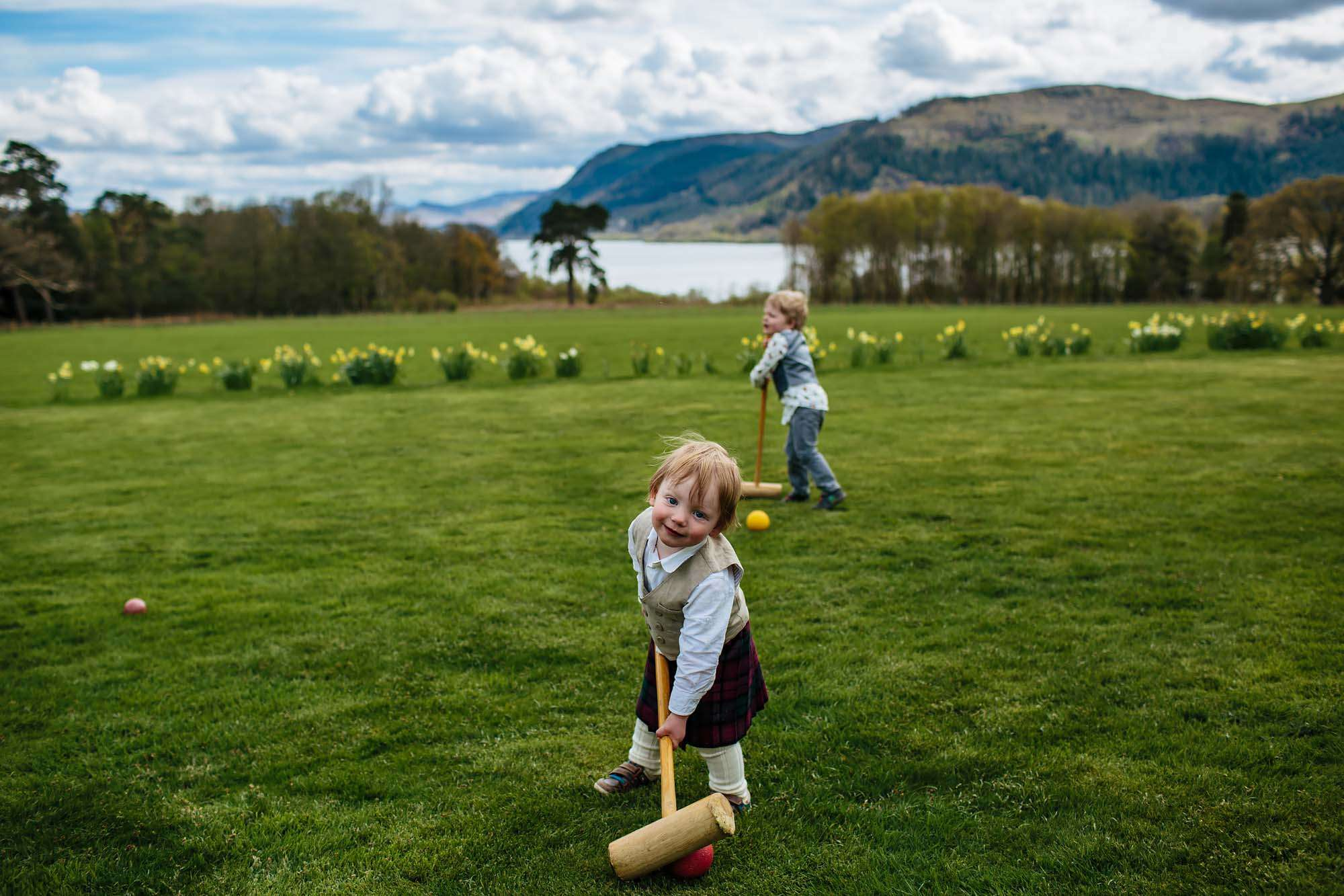 Young boy playing croquet at Lake Bassenthwaite