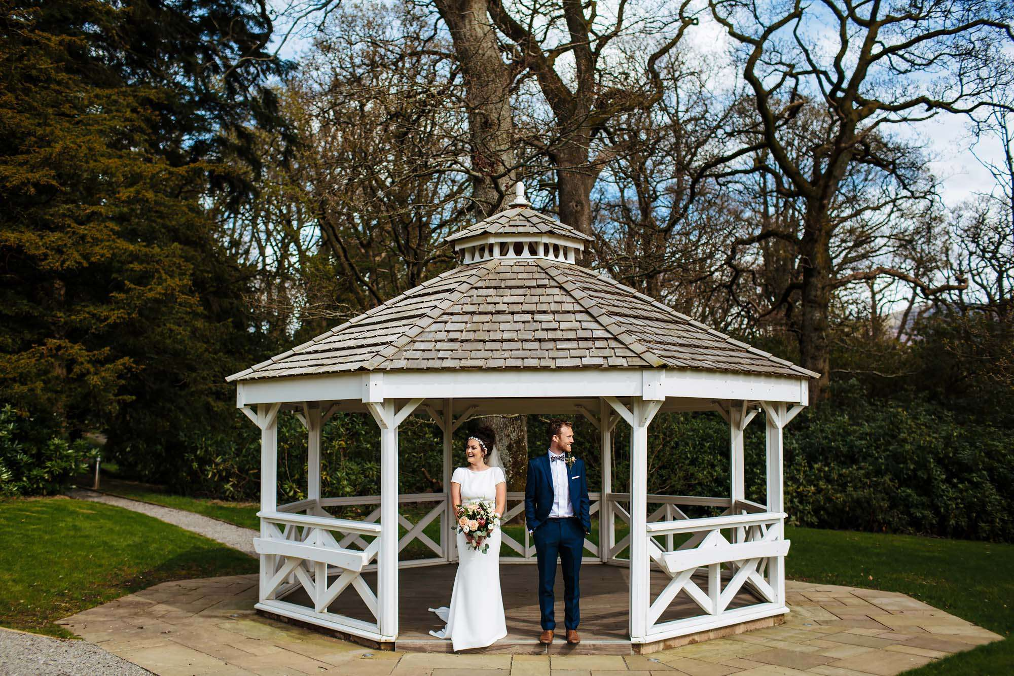 Bride and groom portrait in the bandstand at Armathwaite Hall