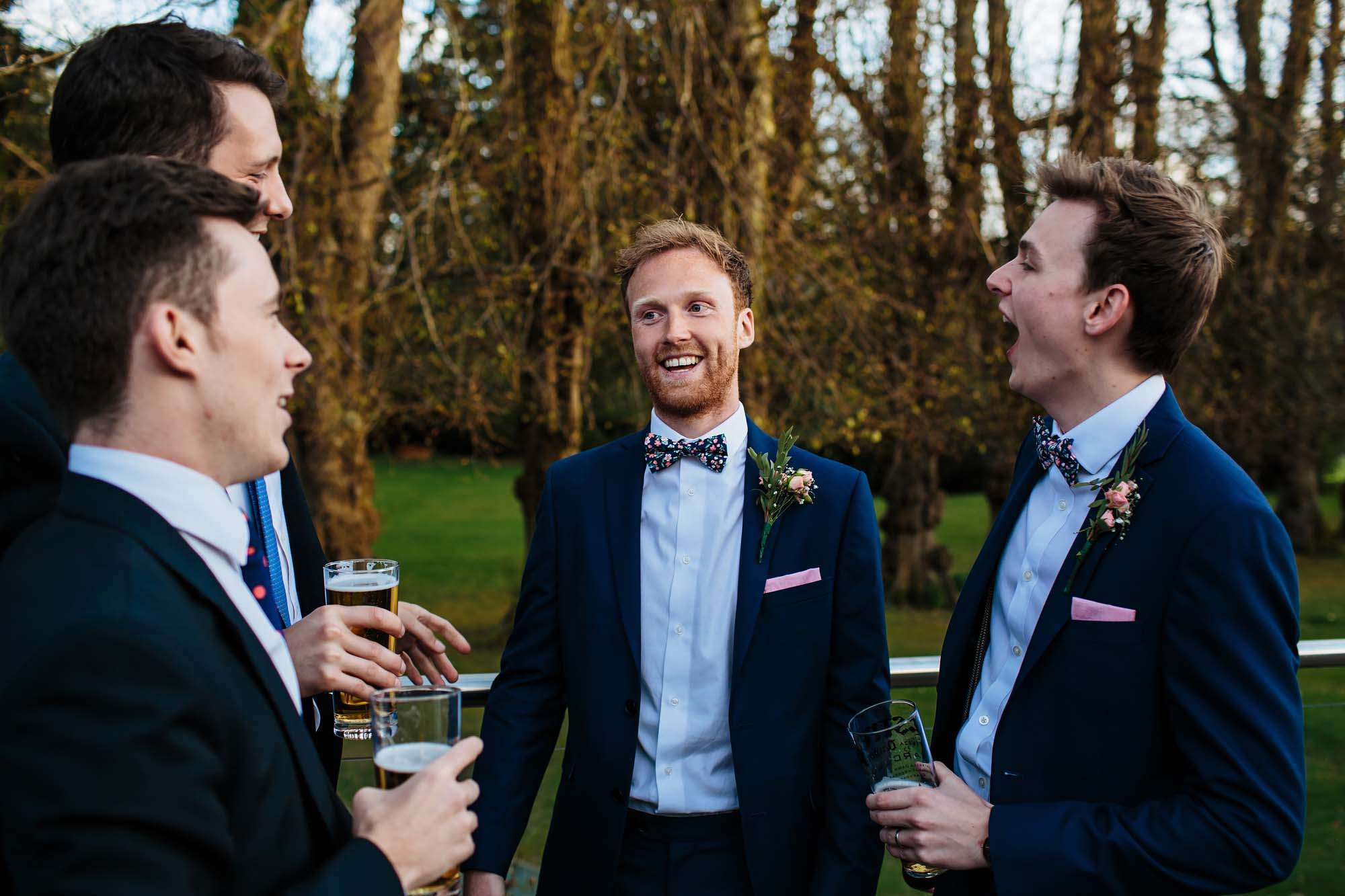 Groom and the boys laughing at a wedding at Armathwaite Hall