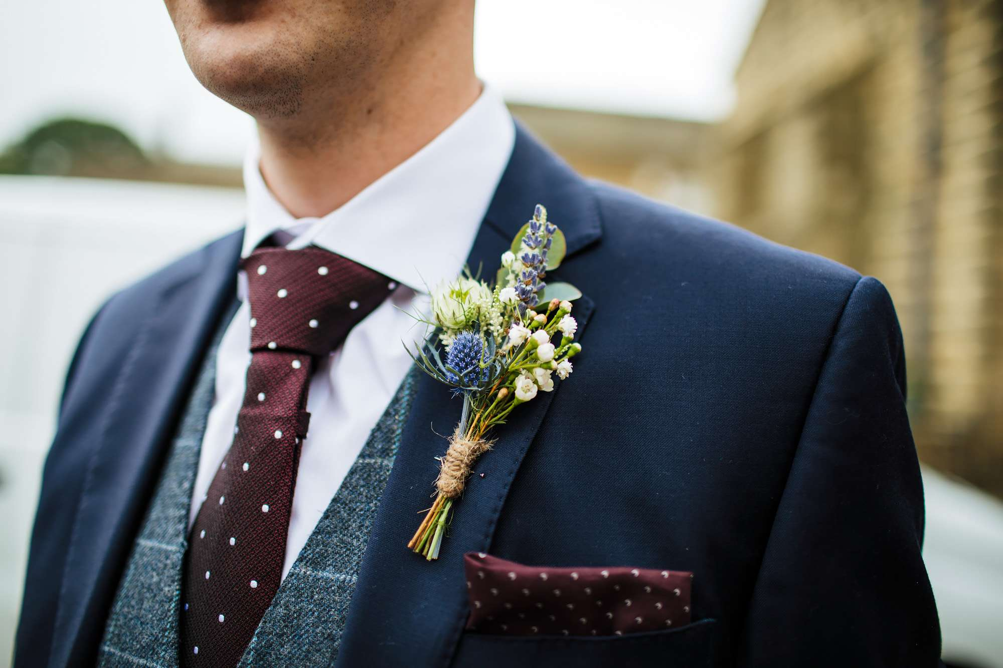 Grooms buttonhole with purple flowers