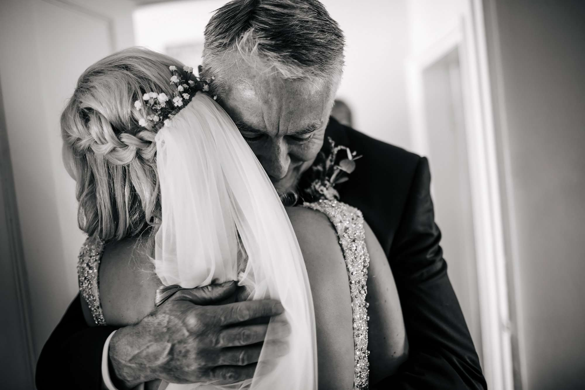 An emotional father and bride hug on her wedding morning in Leeds
