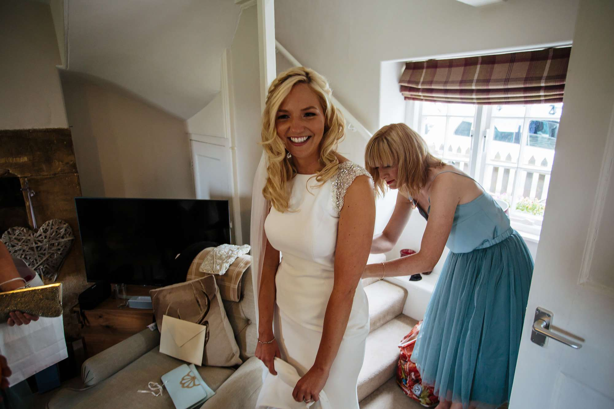 Bride having her dress fitted on her wedding morning in Leeds