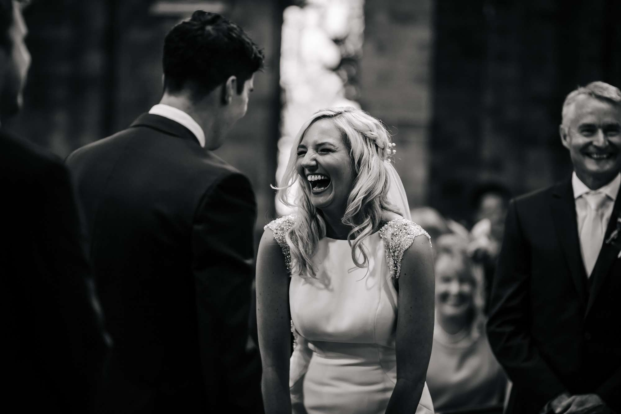 Bride laughing at a Leeds church wedding