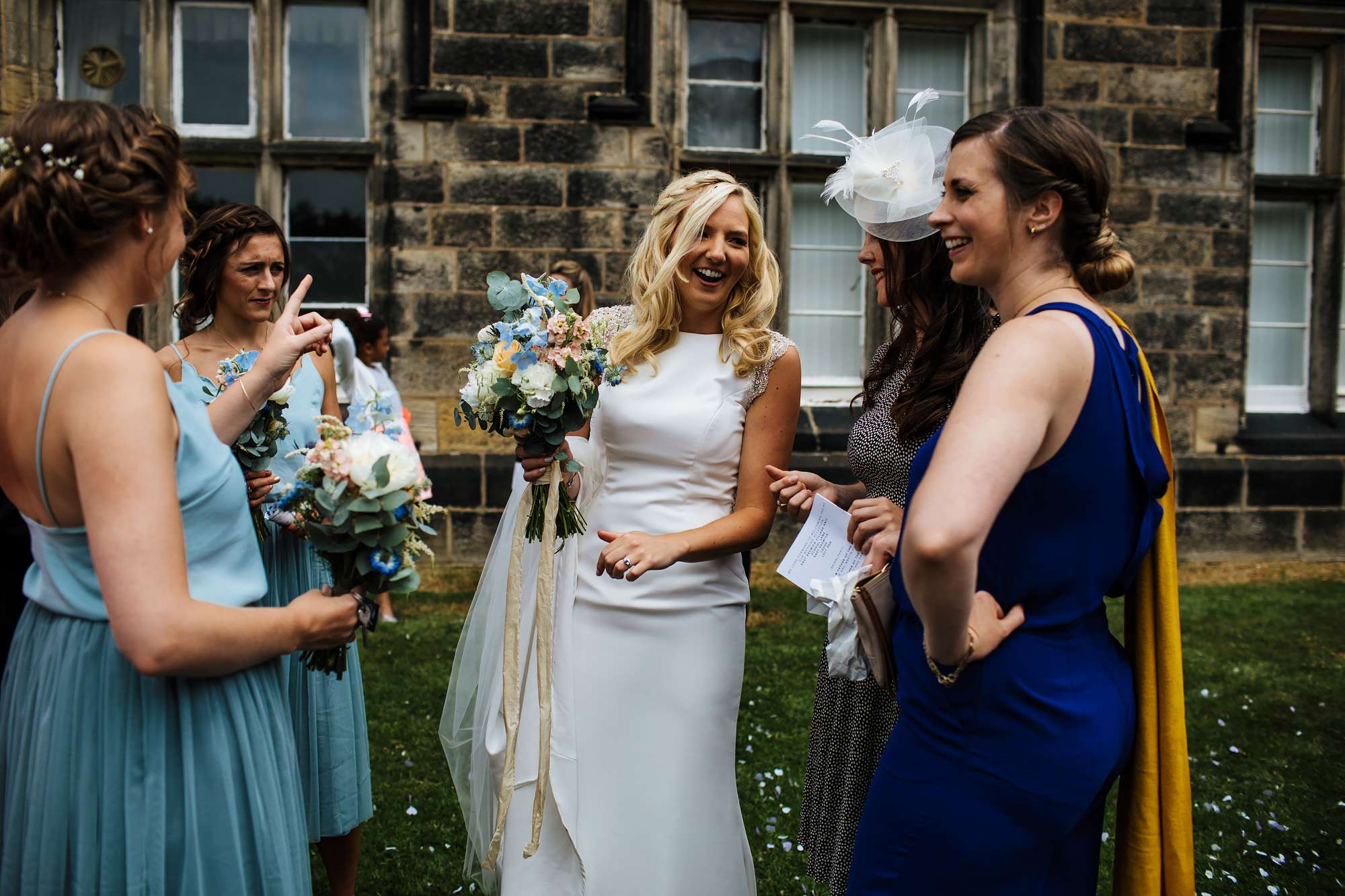 Bride laughing with guests at her Leeds wedding