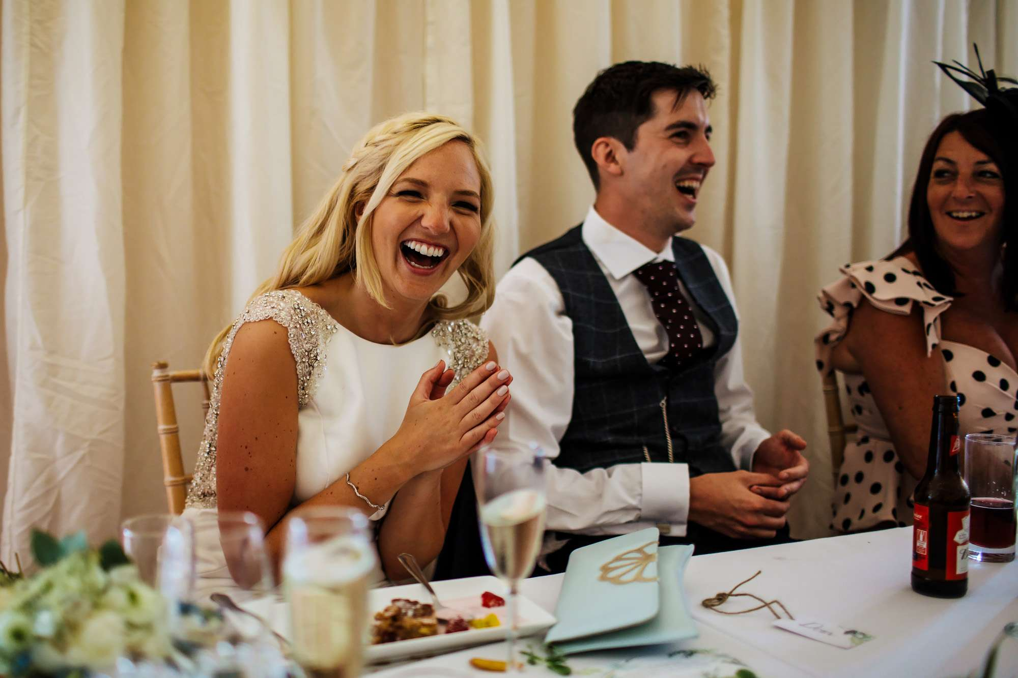 Bride laughing during the speeches at her Leeds wedding