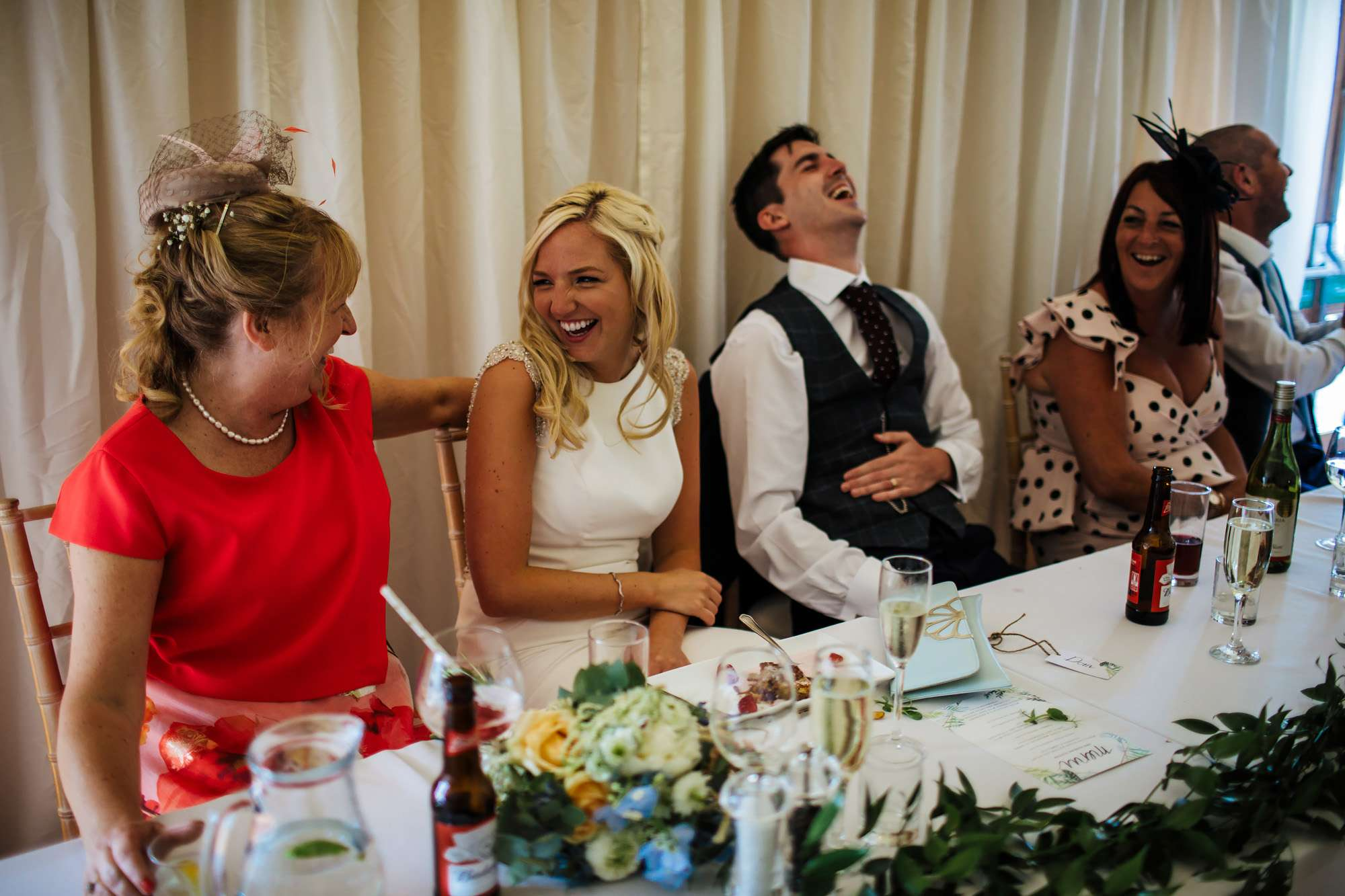 Bride and mum laughing at East Keswick Village Hall wedding