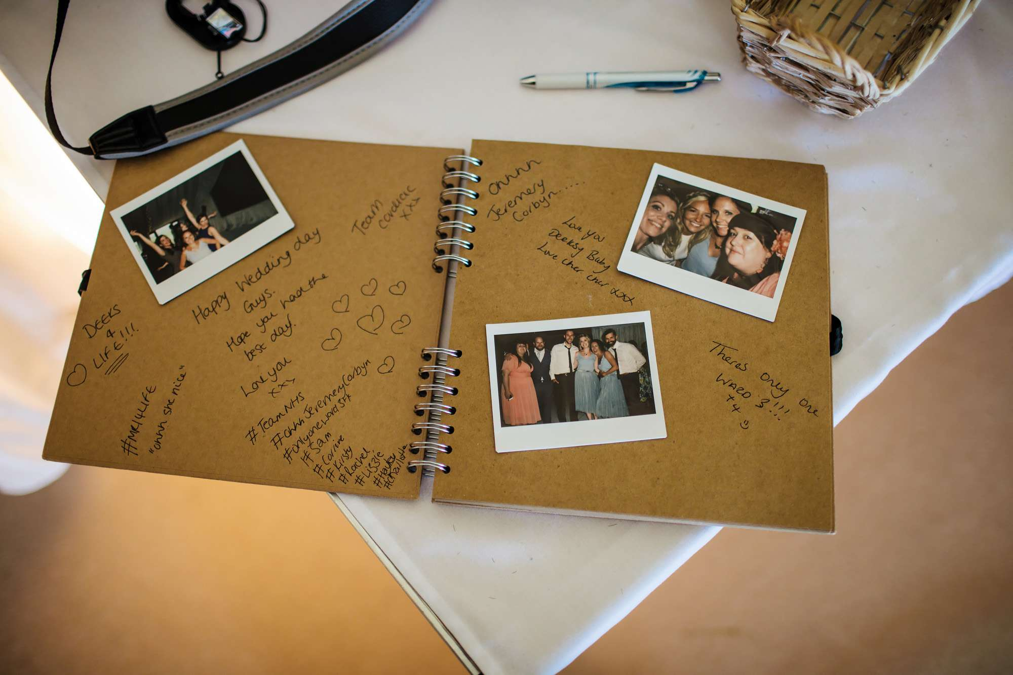 Guestbook with polaroids at East Keswick Village Hall wedding