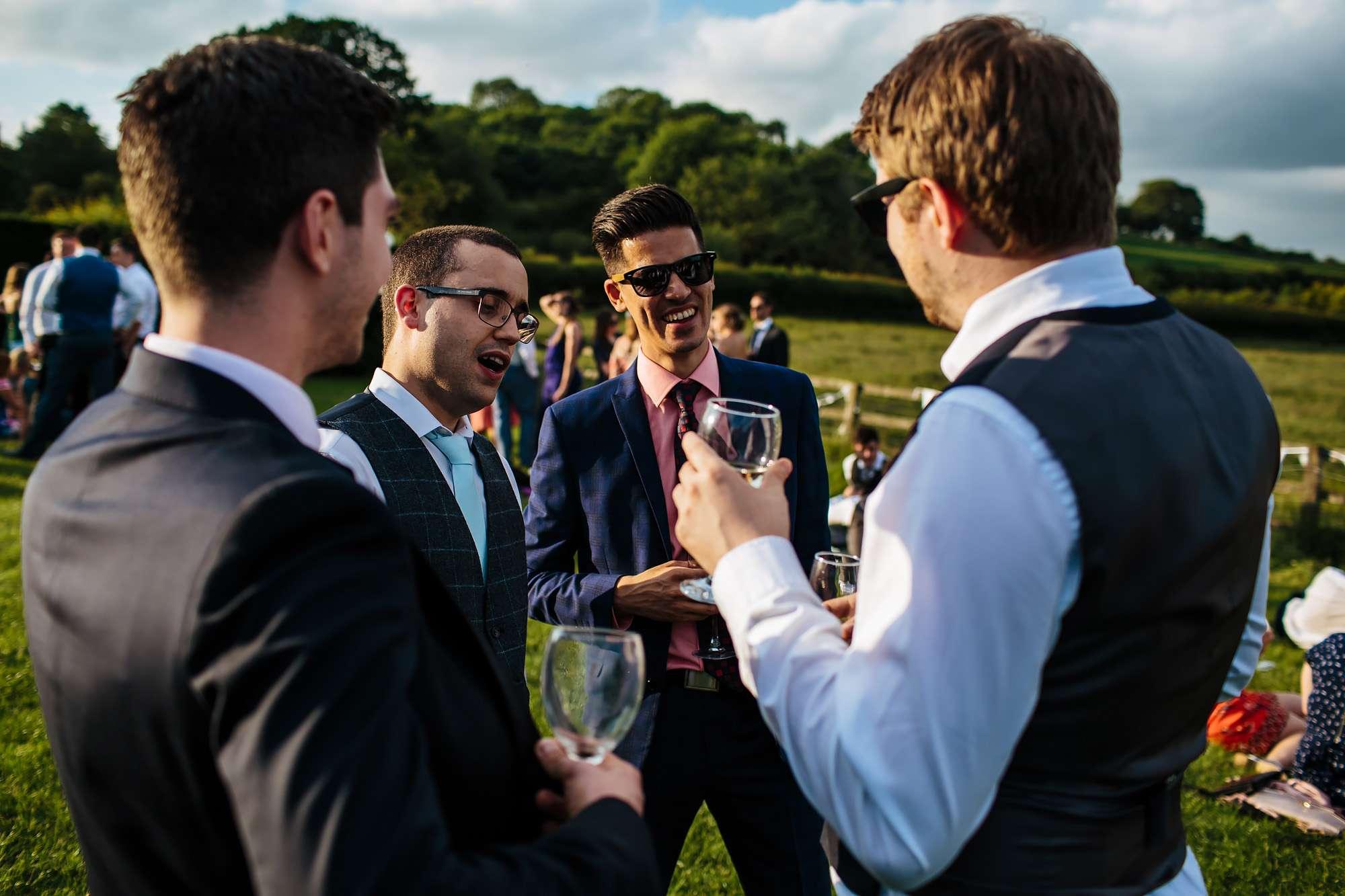 Wedding guests smiling at East Keswick Village Hall