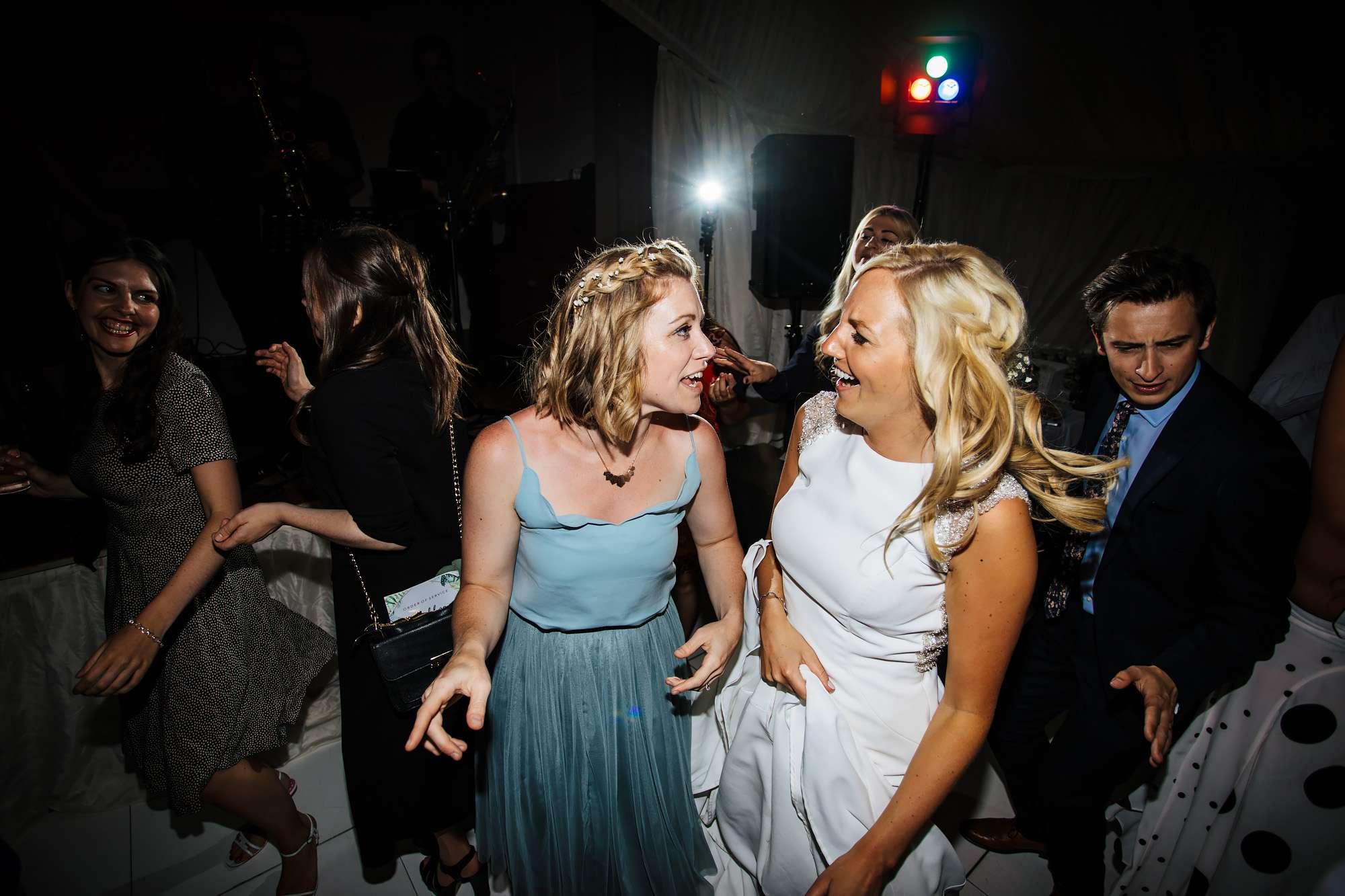 Dance floor fun times at East Keswick Village Hall wedding