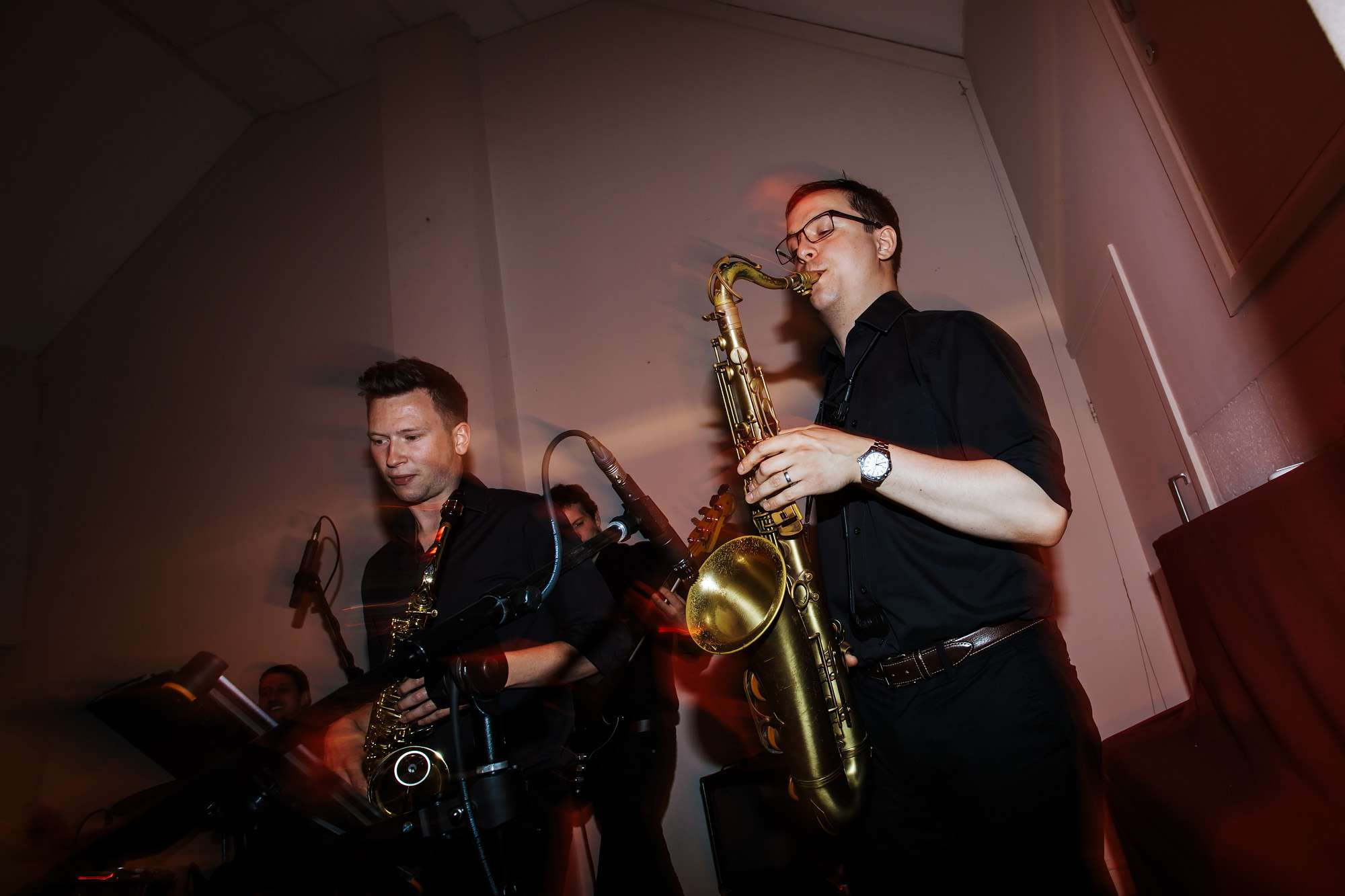Two saxophones in a wedding band at East Keswick Village Hall Leeds