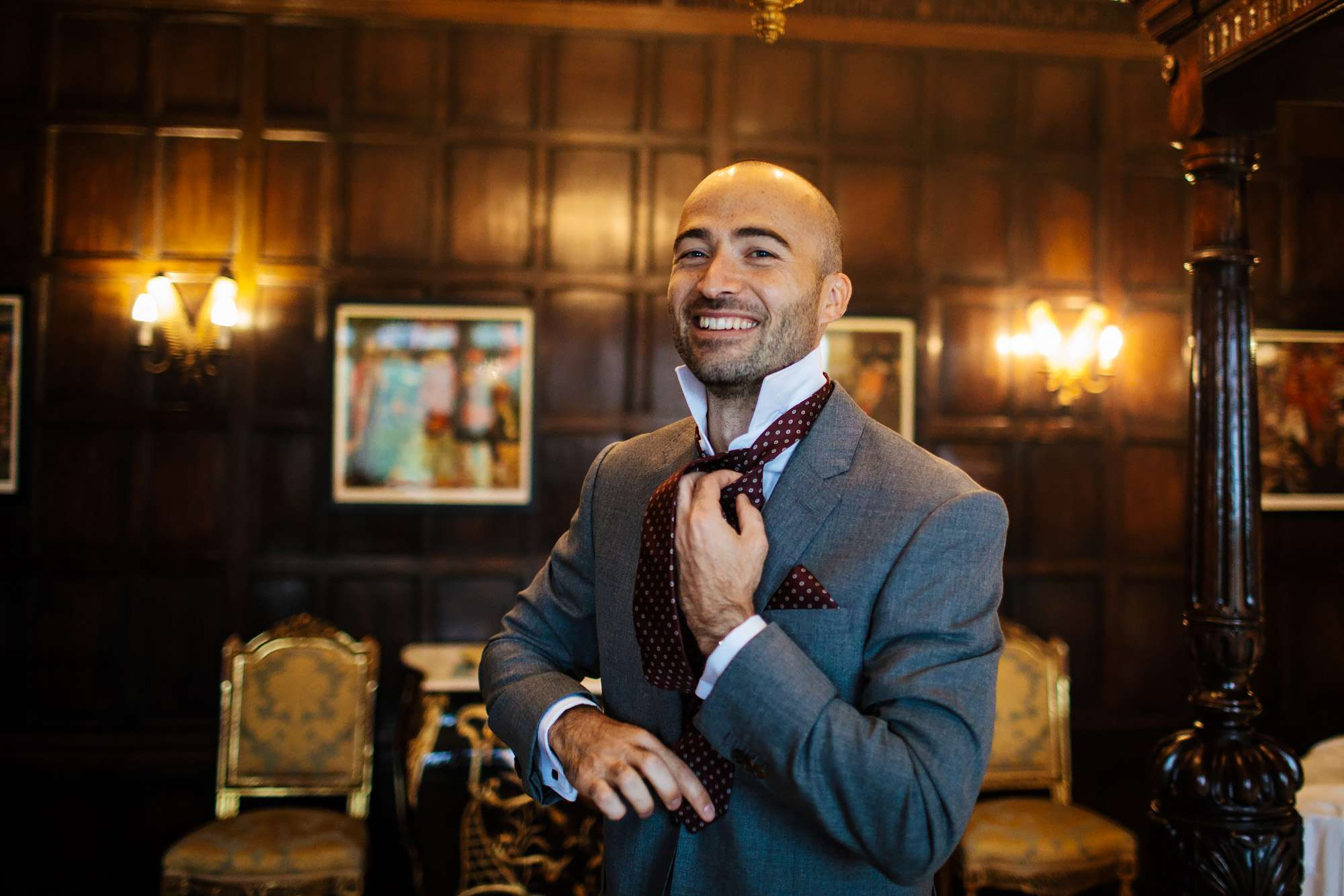 Groom getting dressed at a Cowdray House wedding