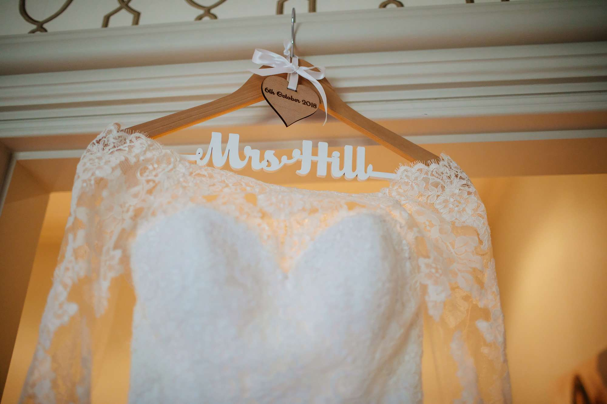 Bride's dress hanging up at Cowdray House