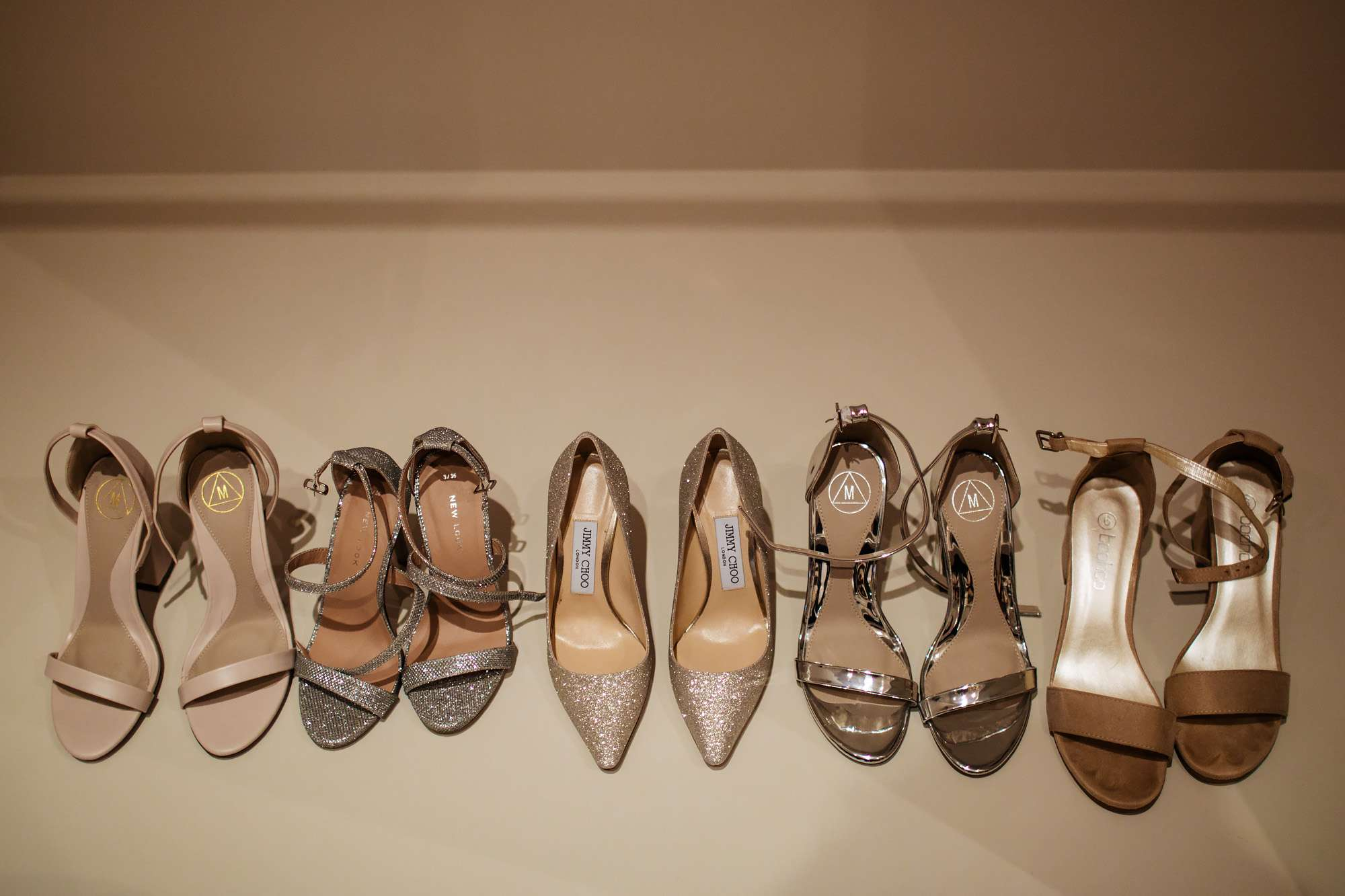 Wedding shoes lined up at Cowdray House